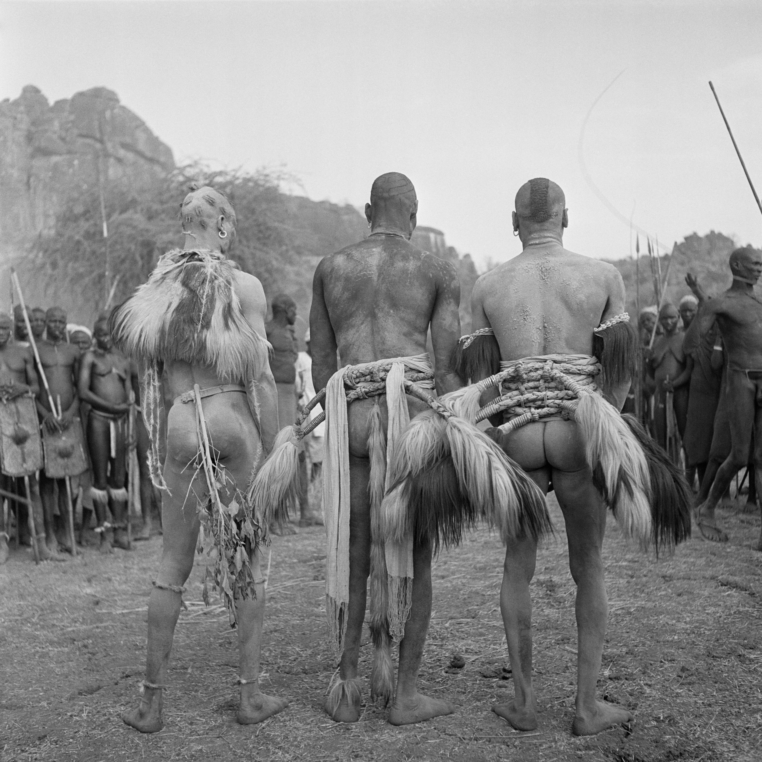 Three Nuba Tribesman, Back. ©George Rodger, from  Southern Sudan . Published by Stanley/Barker.