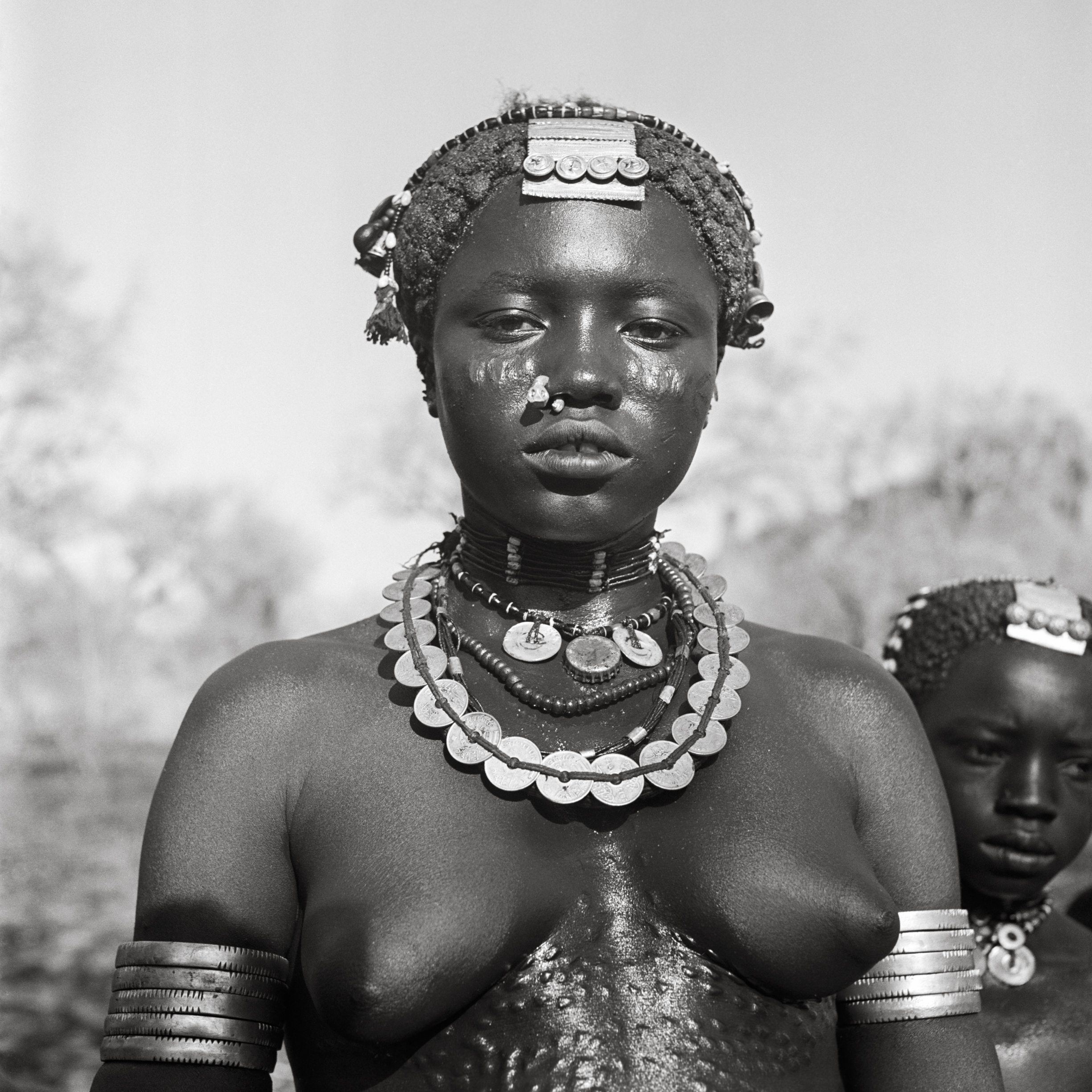 Women of the Koalib Nuba from Delami, 1949. ©George Rodger, from  Southern Sudan . Published by Stanley/Barker.
