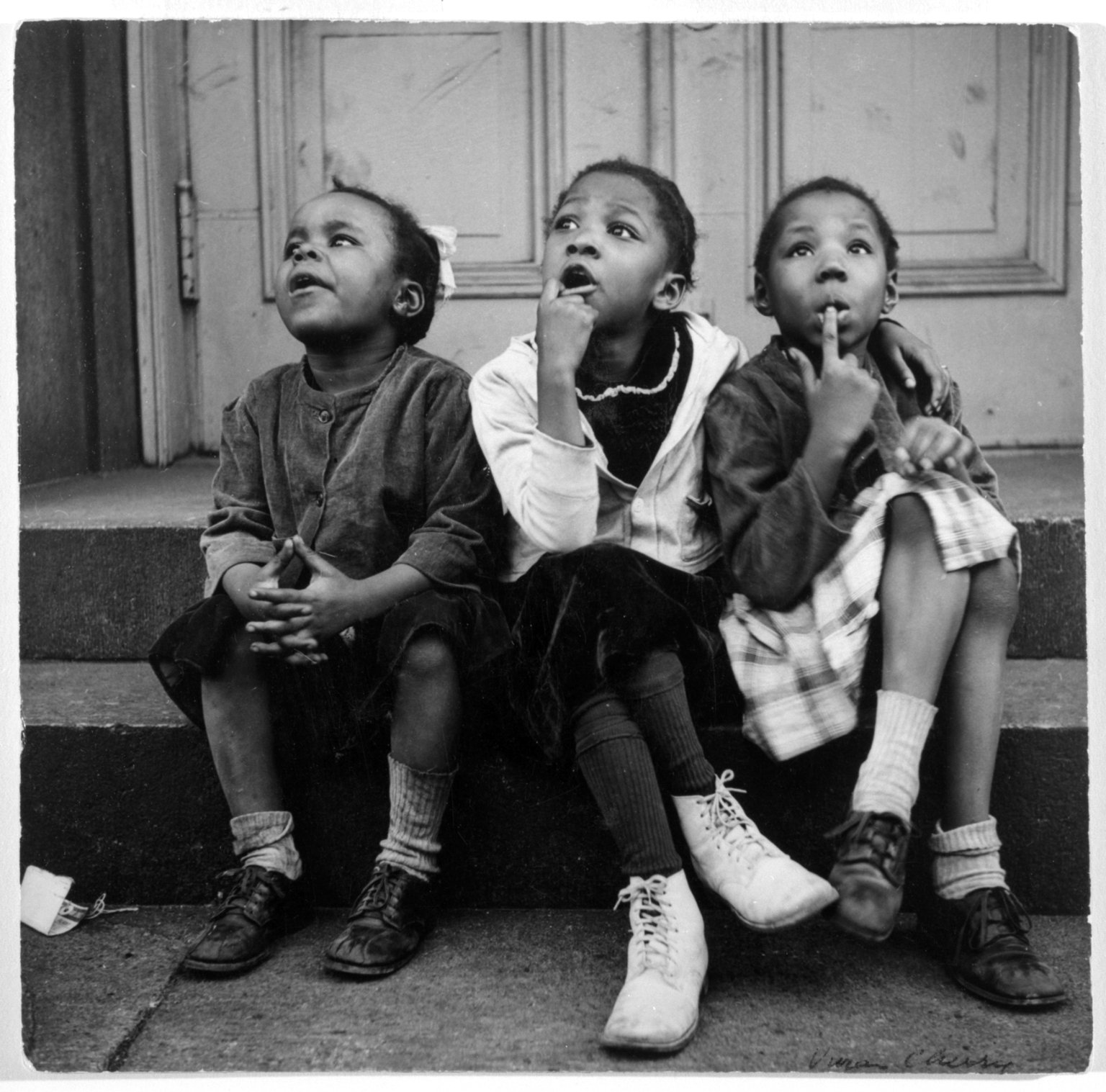 Vivian Cherry (American, born 1920.  Harlem, Watching a Sky Writing Plane,  1952. Gelatin silver photograph, 8 x 8 in. (20.3 x 20.3 cm) Brooklyn Museum. Purchased with funds given by Horace W. Goldsmith Foundation, Harry Kahn, and Mrs. Carl L. Selden, 1994.31.1 ©artist or artist's estate.