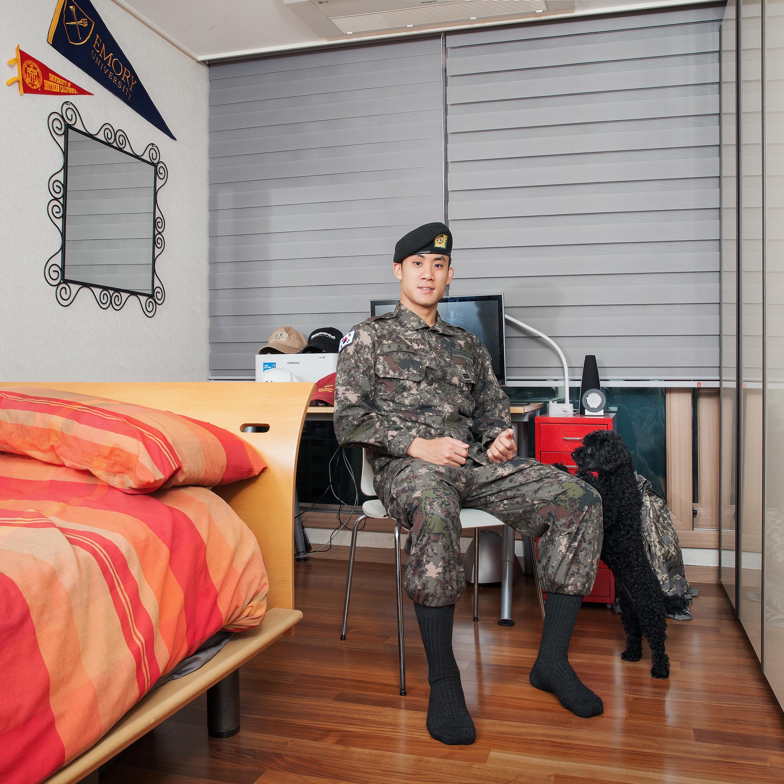 The Blue Project III- Hojune in his room, Seoul, South Korea. Light jet print, 2018. ©JeongMee Yoon