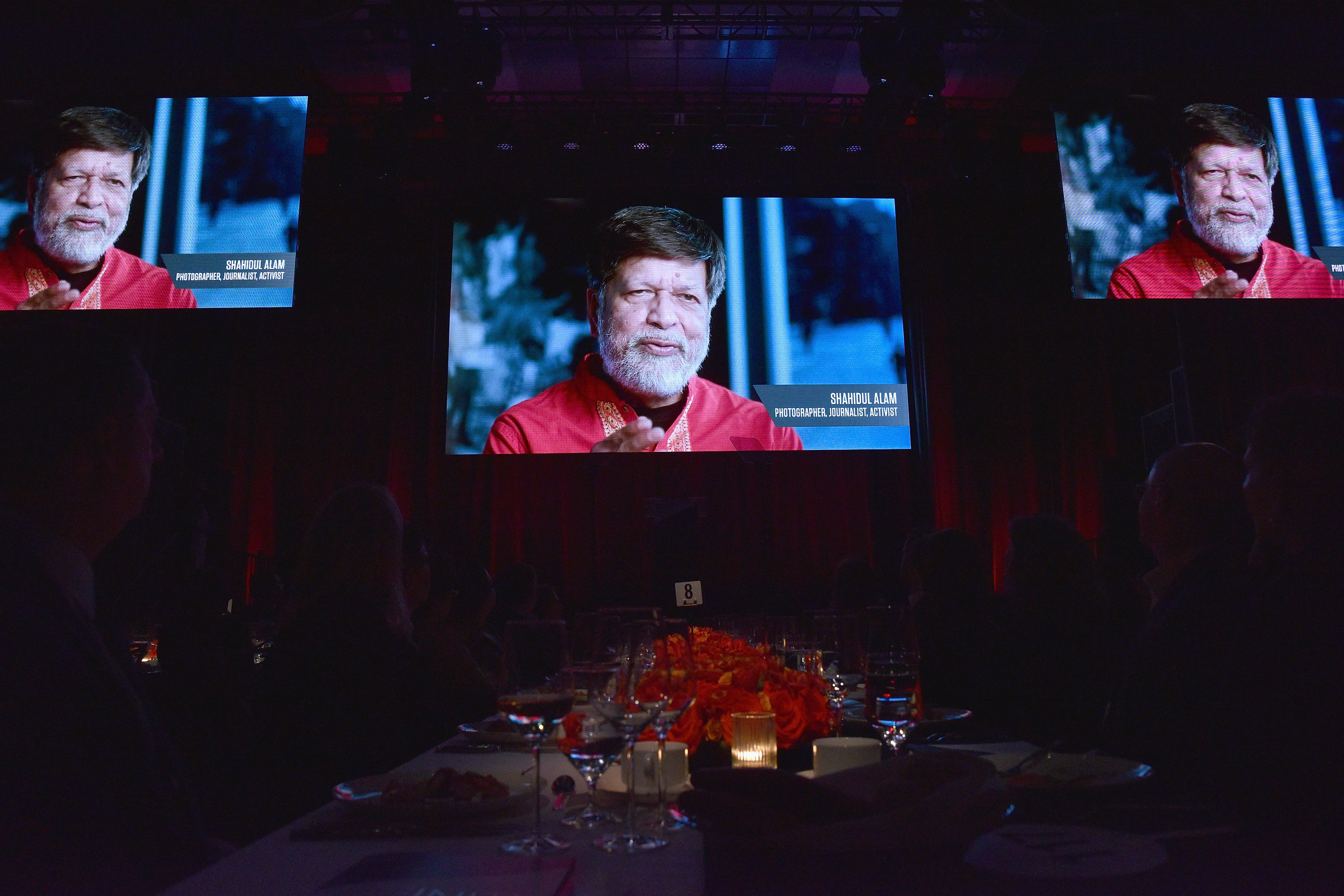 NEW YORK, NY - APRIL 02: Guests watch a video featuring honoree and photographer Shahidul Alam during The International Center Of Photography's 35th Annual Infinity Awards at The Ziegfeld Ballroom on April 2, 2019 in New York City. (Photo by Bryan Bedder/Getty Images for International Center of Photography)