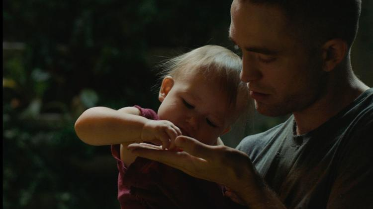"""The last surviving prisoner trapped on an interstellar mission (Robert Pattinson) raises a baby girl (Scarlett Lindsey) in captivity in Claire Denis' """"High Life."""" (A24)"""