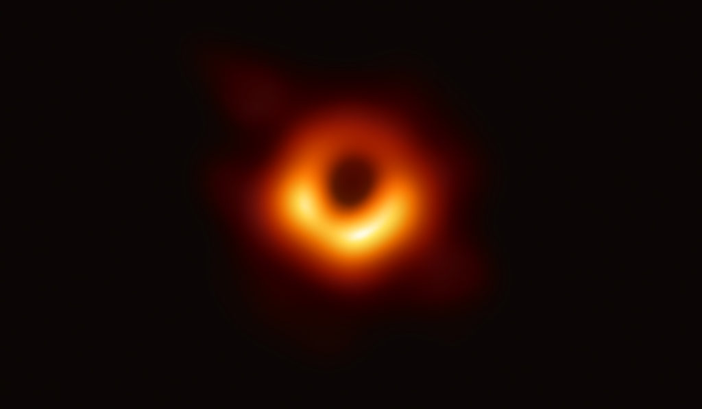 Scientists have obtained the first image of a black hole, using Event Horizon Telescope observations of the center of the galaxy M87. The image shows a bright ring formed as light bends in the intense gravity around a black hole that is 6.5 billion times more massive than the Sun. This long-sought image provides the strongest evidence to date for the existence of supermassive black holes and opens a new window onto the study of black holes, their event horizons, and gravity. Credit: Event Horizon Telescope Collaboration. Courtesy of Event Horizon Telescope.