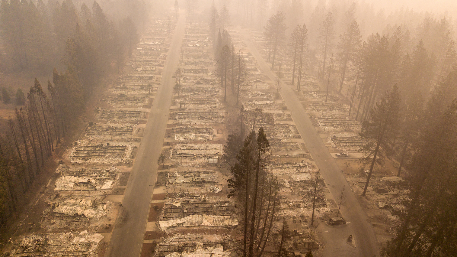Josh Edelson,  In this aerial photo, one of many burned neighborhoods smolders in Paradise, California on November 15, 2018. The Camp fire claimed the lives of 88 people and destroyed more than 180, 804 buildings in the deadliest wildfire in California's recorded history.  (JOSH EDELSON / AFP / Getty Images)