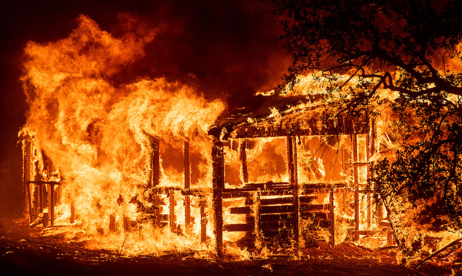 Noah Berger, California Wildfires, A structure burns as the Carr Fire races along Highway 299, near Redding, Calif., on Thursday, July 26, 2018.