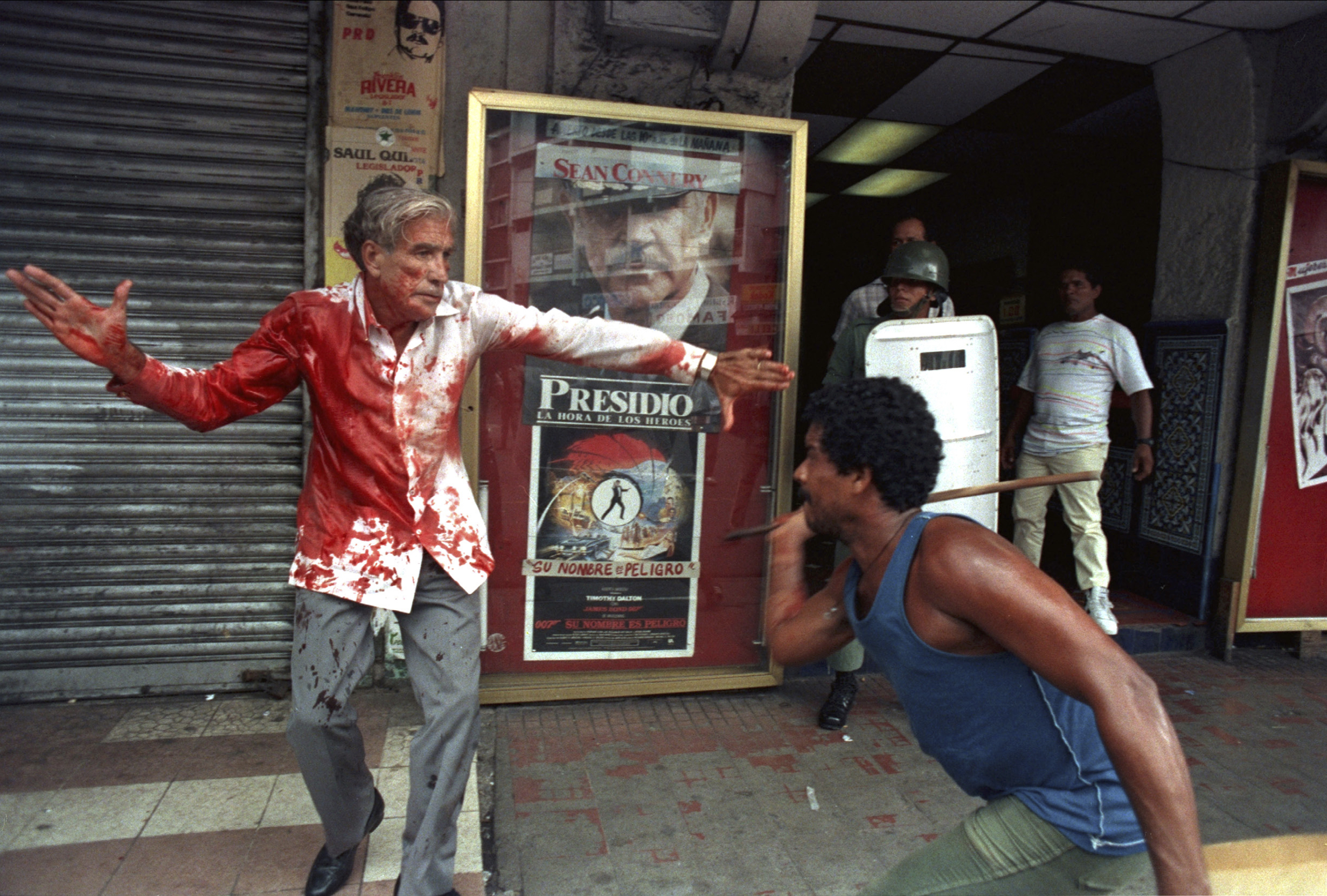 Ron Haviv.  Supporters of Panamanian dictator Manuel Noriega attack elected Vice President Guillermo (Billy) Ford in Panama City. The image was stated by US President Bush as one of the reasons for the invasion of Panama.  1989.