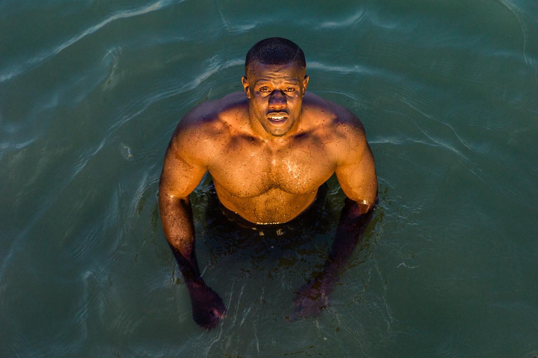A wrestler swimming in Joal. © Werner Mansholt