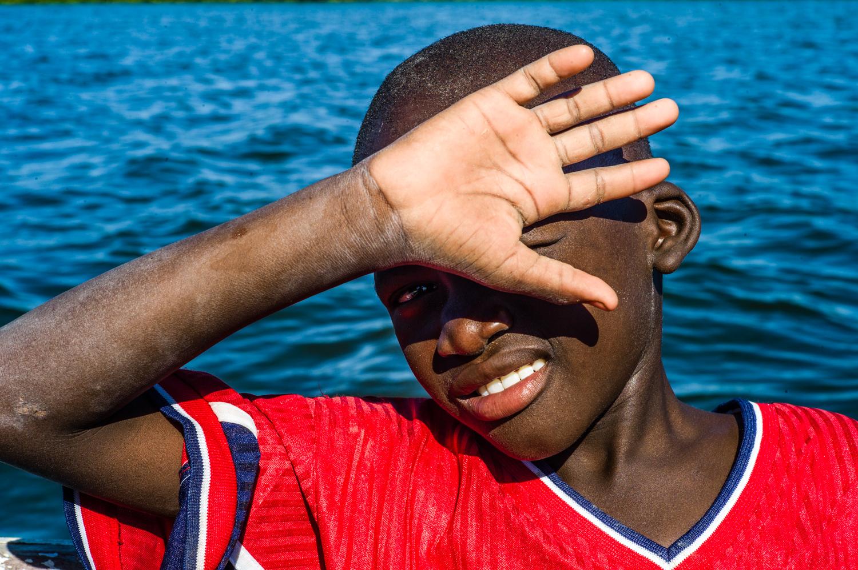 A boy on a boat in Joal. © Werner Mansholt