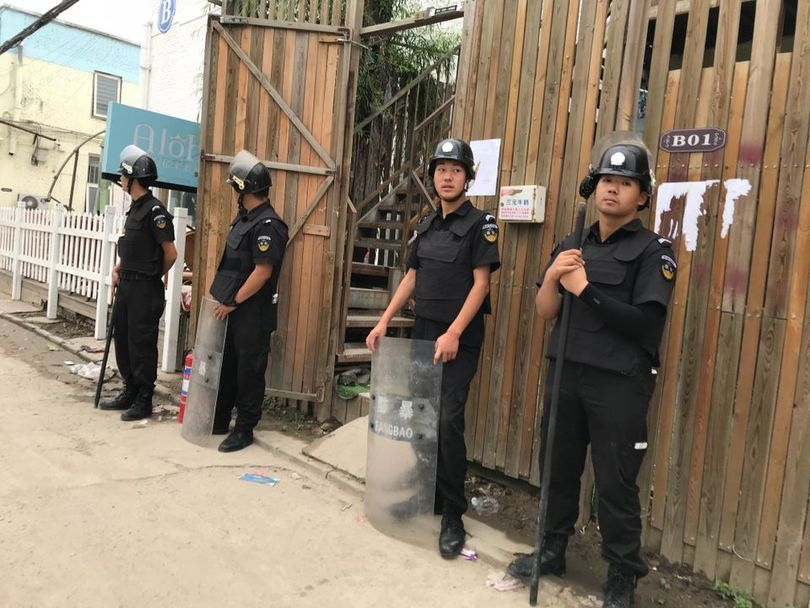 Police in the Huantie Art District in Beijing. Photo by Canon Duan.