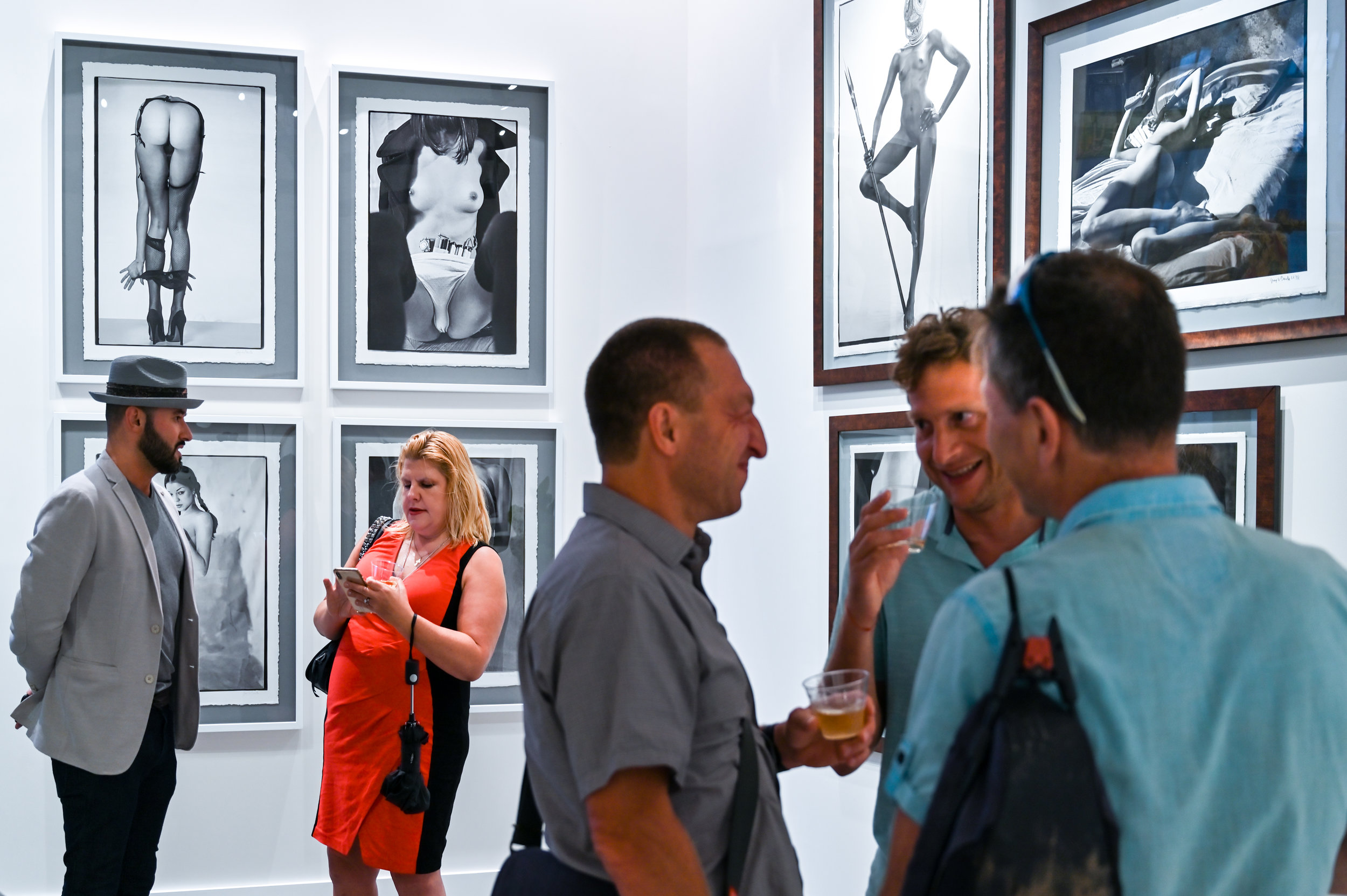 Dmitry Prut, Founder and President of Avant Gallery, with visitors. © Federica Belli