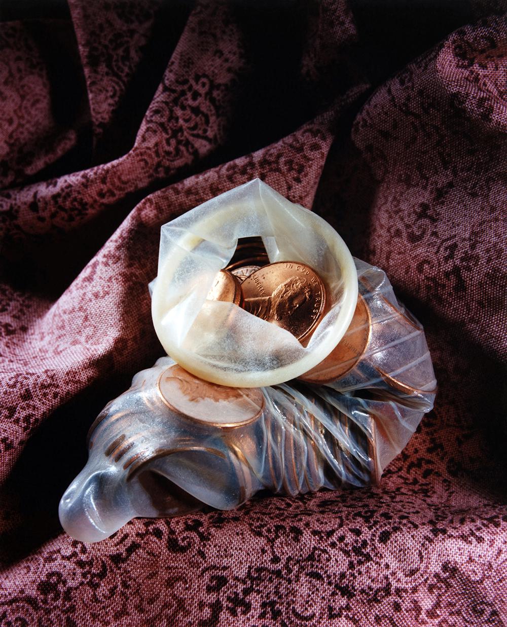 """Condom Pennies"" 2018, C-print © Ashley Miller"