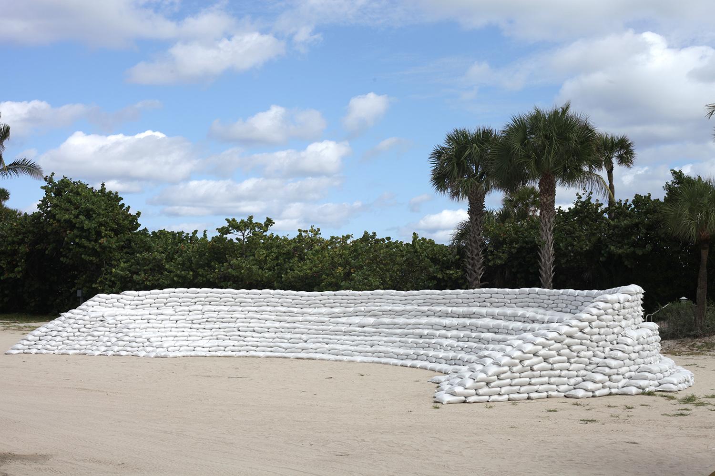 Sand: Amphitheater, Theater, Arena , 2018, 176 cubic yards of sand in 6,000 standard flood mitigation sandbags, Miami Beach, Florida. © Misael Soto Photo credit: Phillip Karp http://misaelsoto.com/