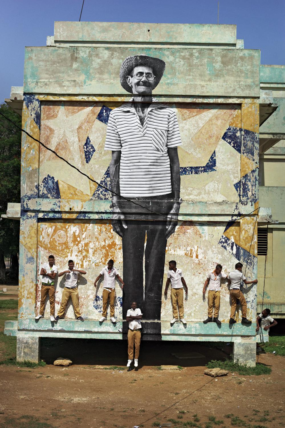 The Wrinkles of the City, La Havana, Antonio Cruz Gordillo,  (artwork by JR, project by JR & José Parlá) Cuba , 2012, Color photograph, matte plexiglass, aluminum, wood, 267 x 180 cm | 105 1/8 x 70 3/4 in. © Courtesy of ©JR-ART.NET