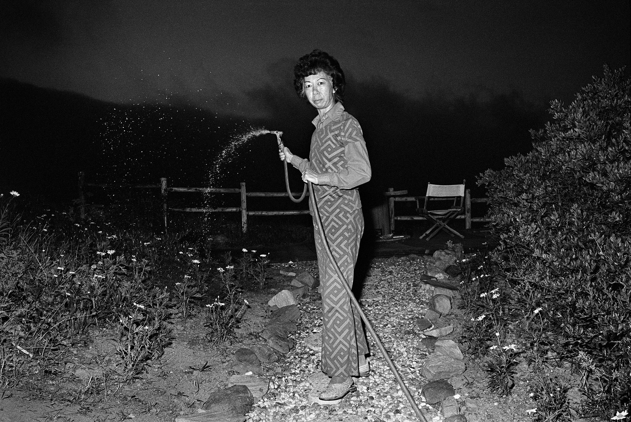 LUCY WATERING AT NIGHT, 1973 © Michael Jang