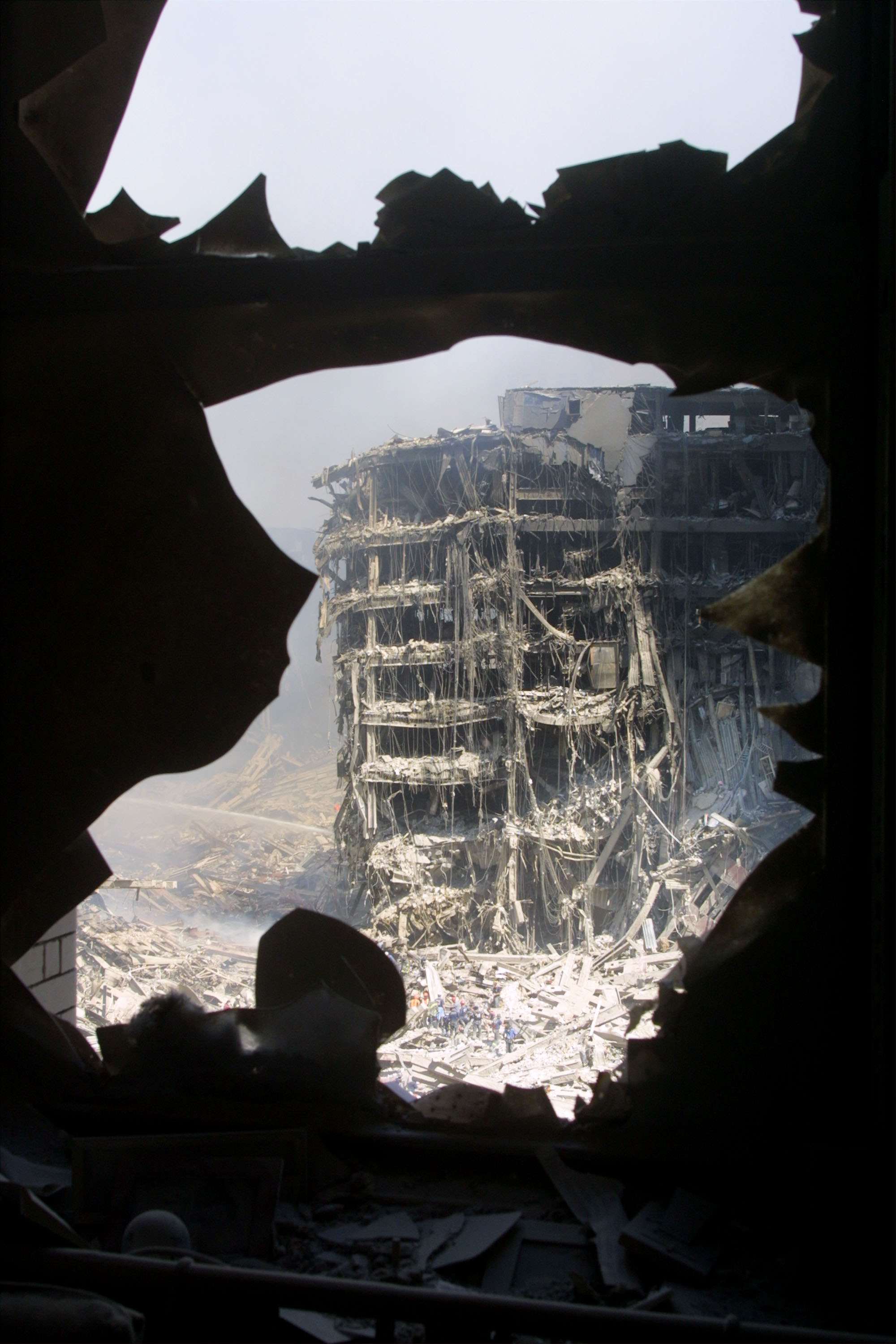 Rescue Workers Search Through WTC Rubble. Credit Mario Tama, courtesy of Getty Images
