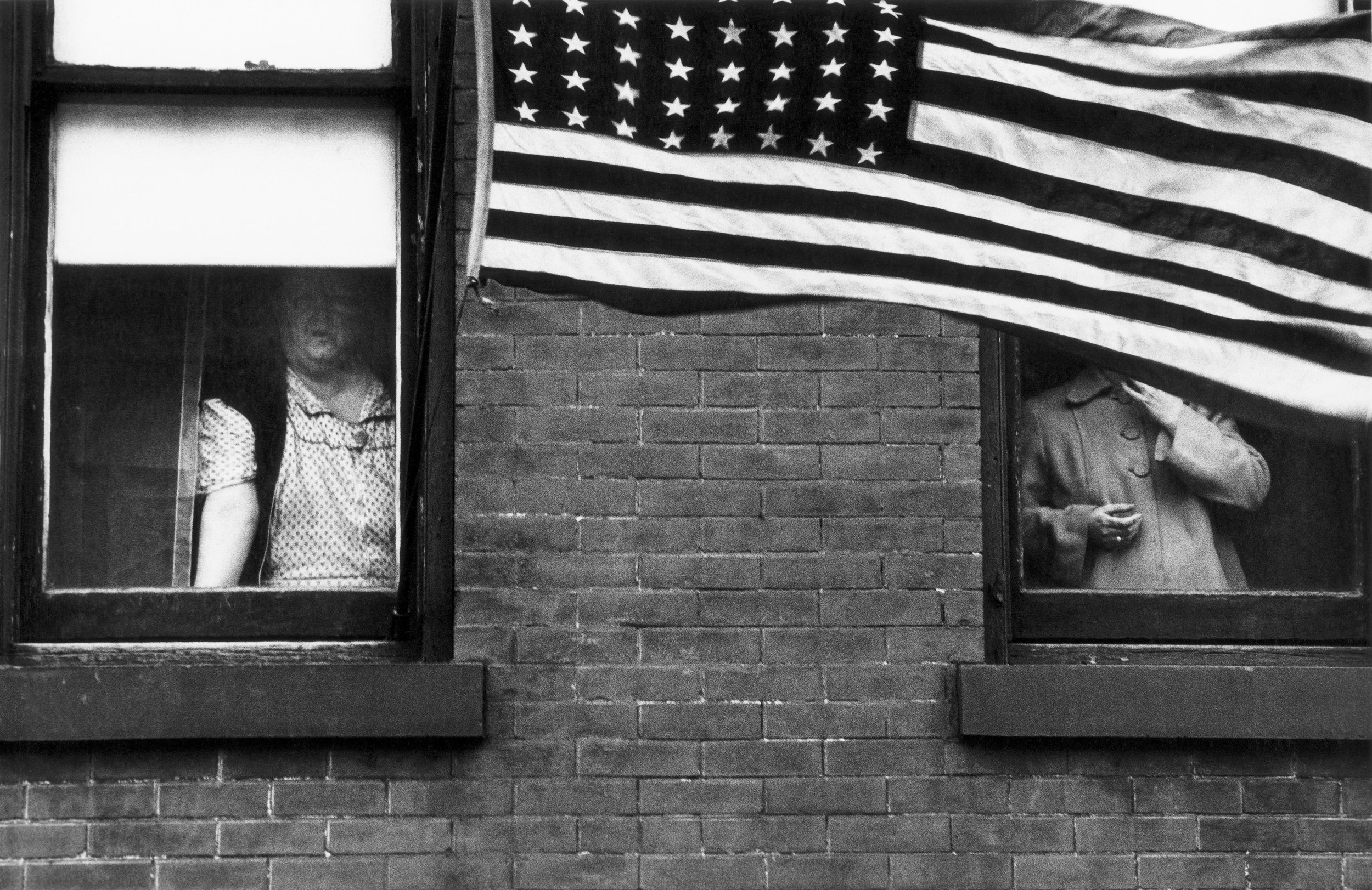 Parade – Hoboken, New Jersey, 1955 © Robert Frank from The Americans, courtesy Pace/MacGill