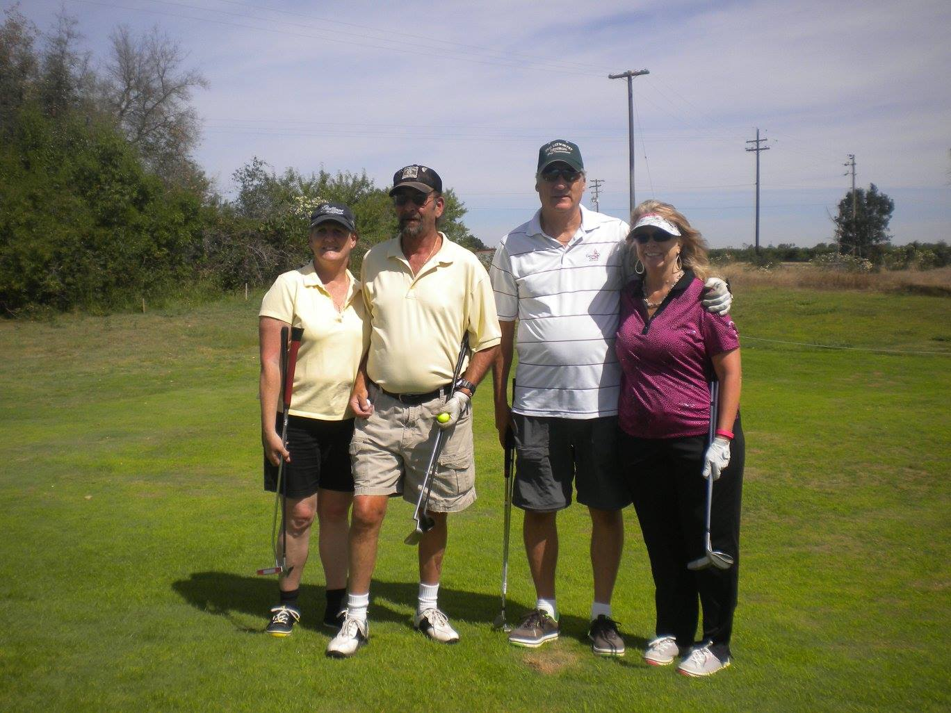 Couples Golf Team.jpg