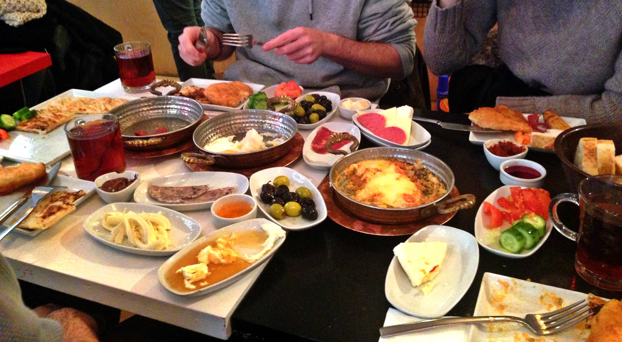 THIS IS A TRADITIONAL TURKISH BREAKFAST. SMALL PLATES OF ASSORTED SWEET AND SAVORY EATS