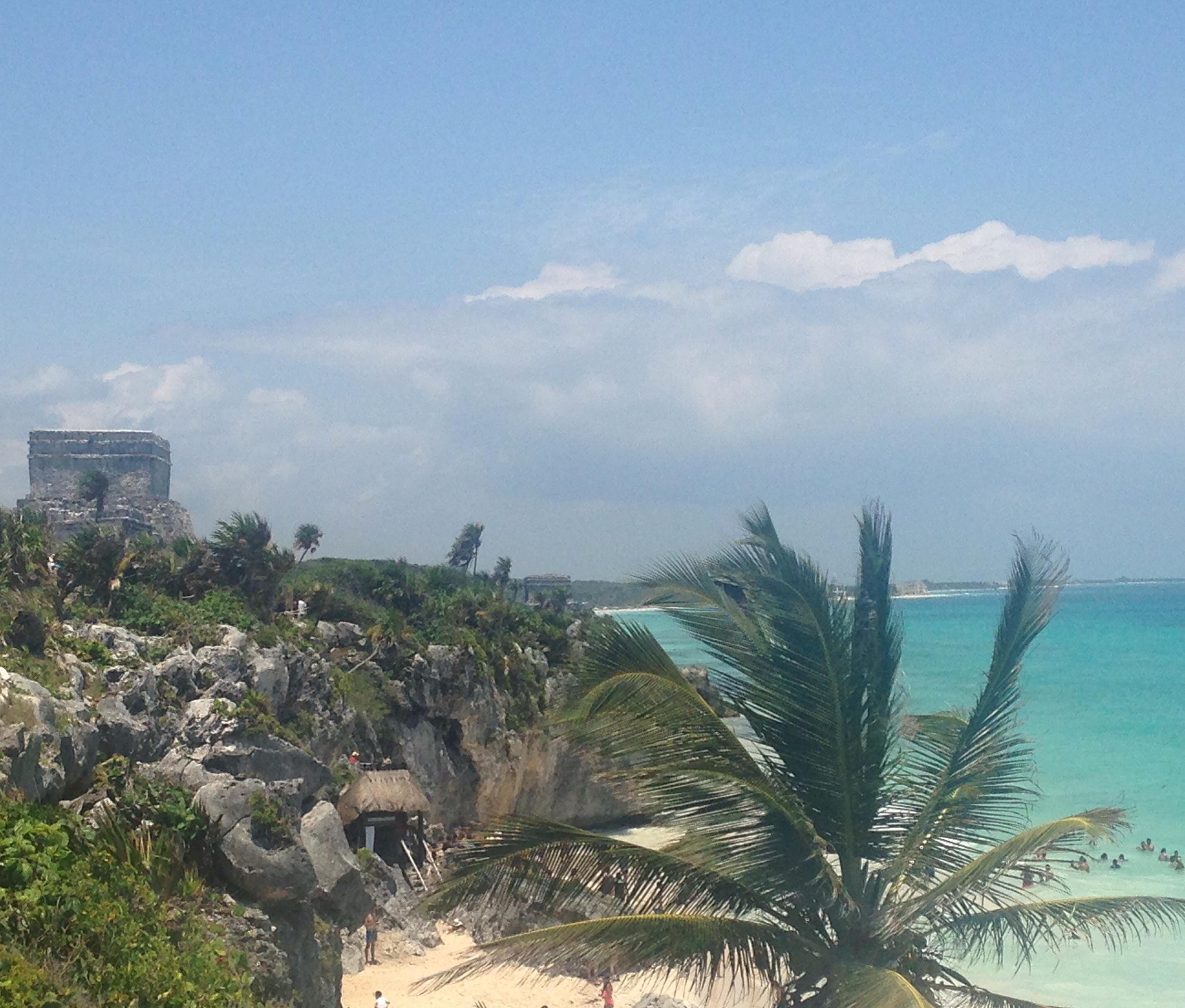 A VIEW OF THE RUINS AND THE BEACH IN TULUM