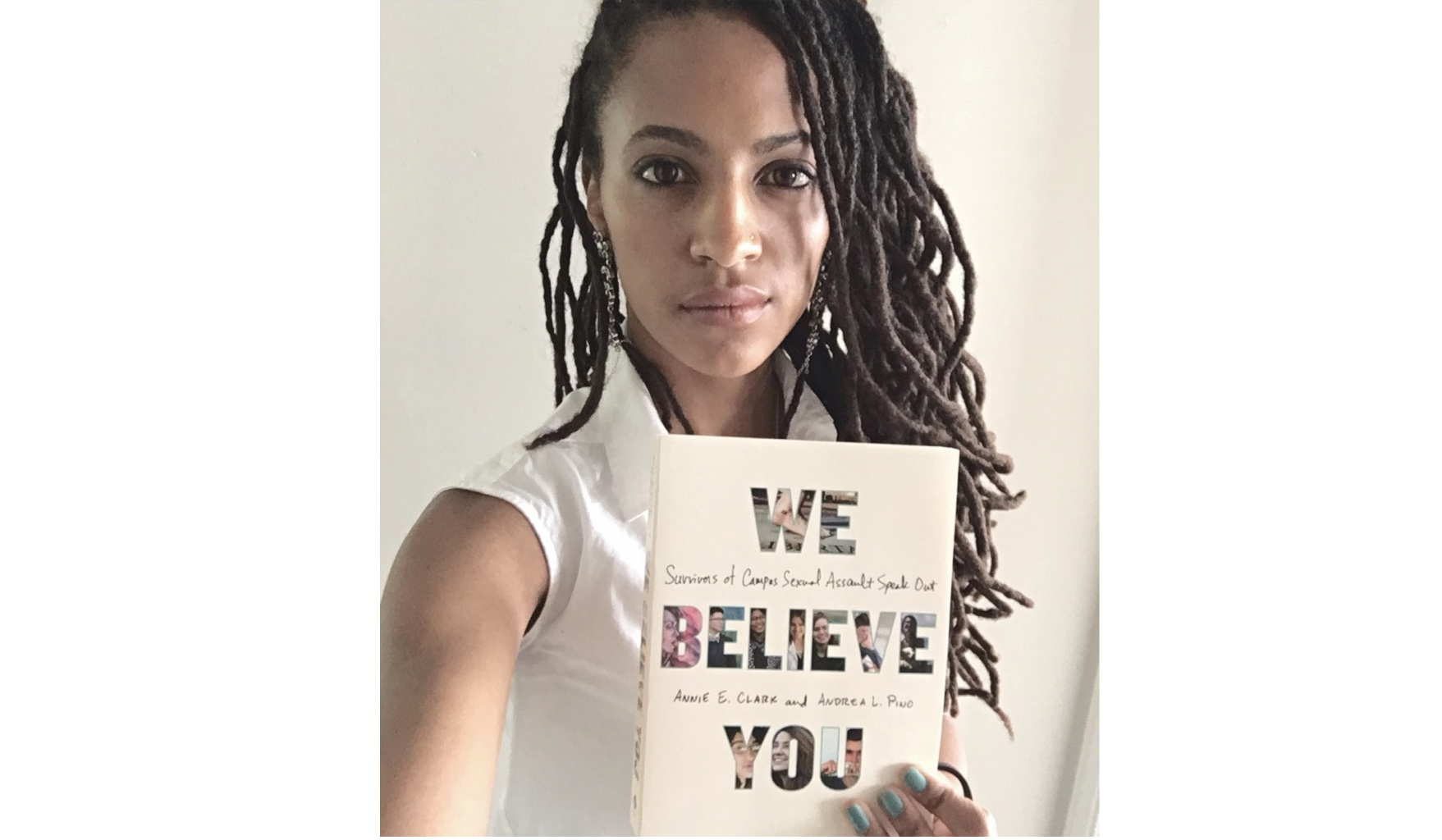 Kamilah with a copy of the book   We Believe You : Survivors of Campus Sexual Assault Speak Out.