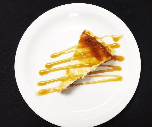 CREOLE CREAM CHEESECAKE  Housemade Creole Cream Cheesecake with Caramel Sauce  $48/whole cake, 12 slices