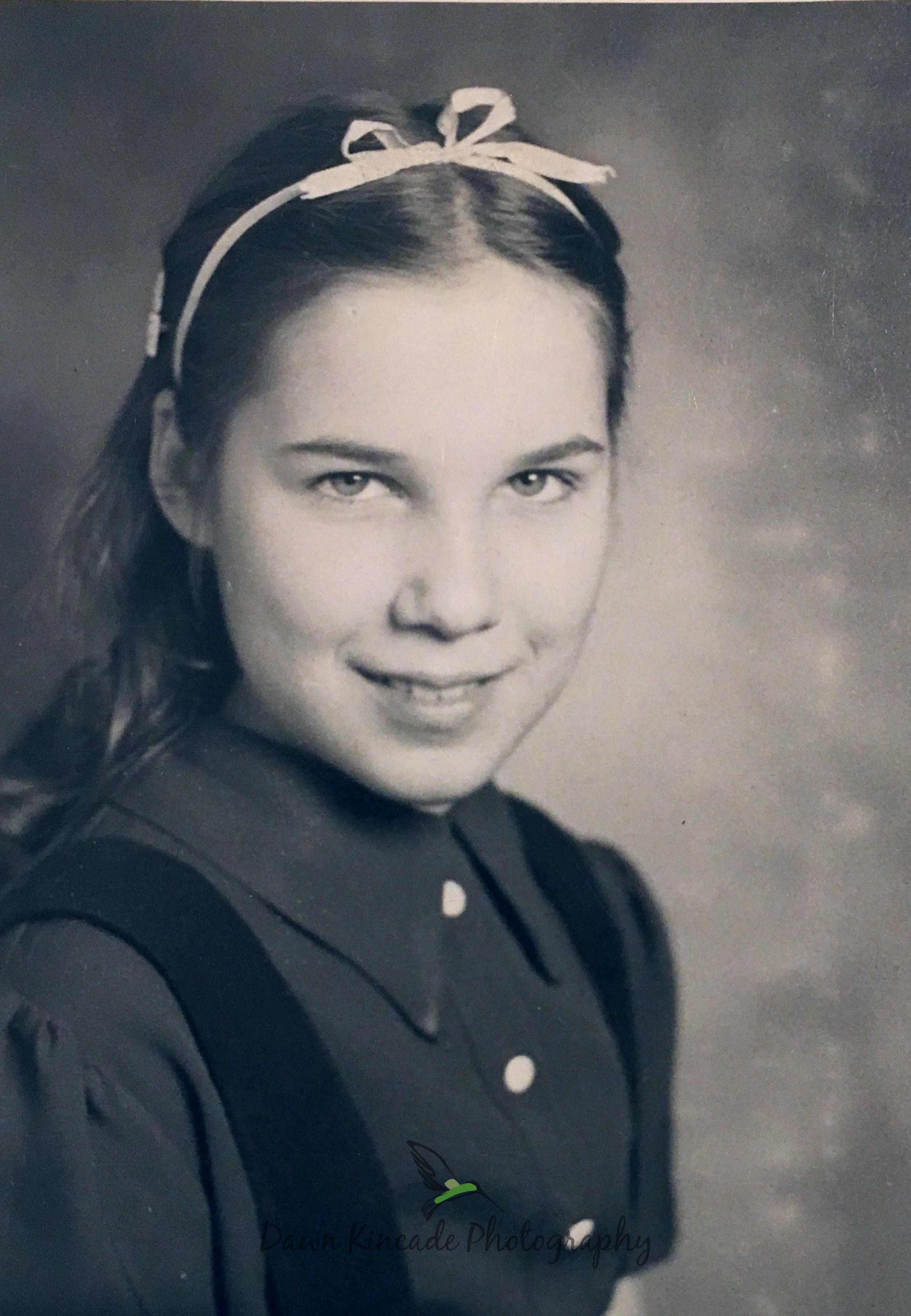 My Mom as a young girl. This is not a photo that I took. This is a scanned copy of an original that photo.