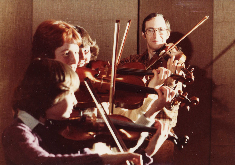 1981 Dr._Burgess-Students-Mary_Osoko-Karma_Tomm-Sandy_Baron.JPG