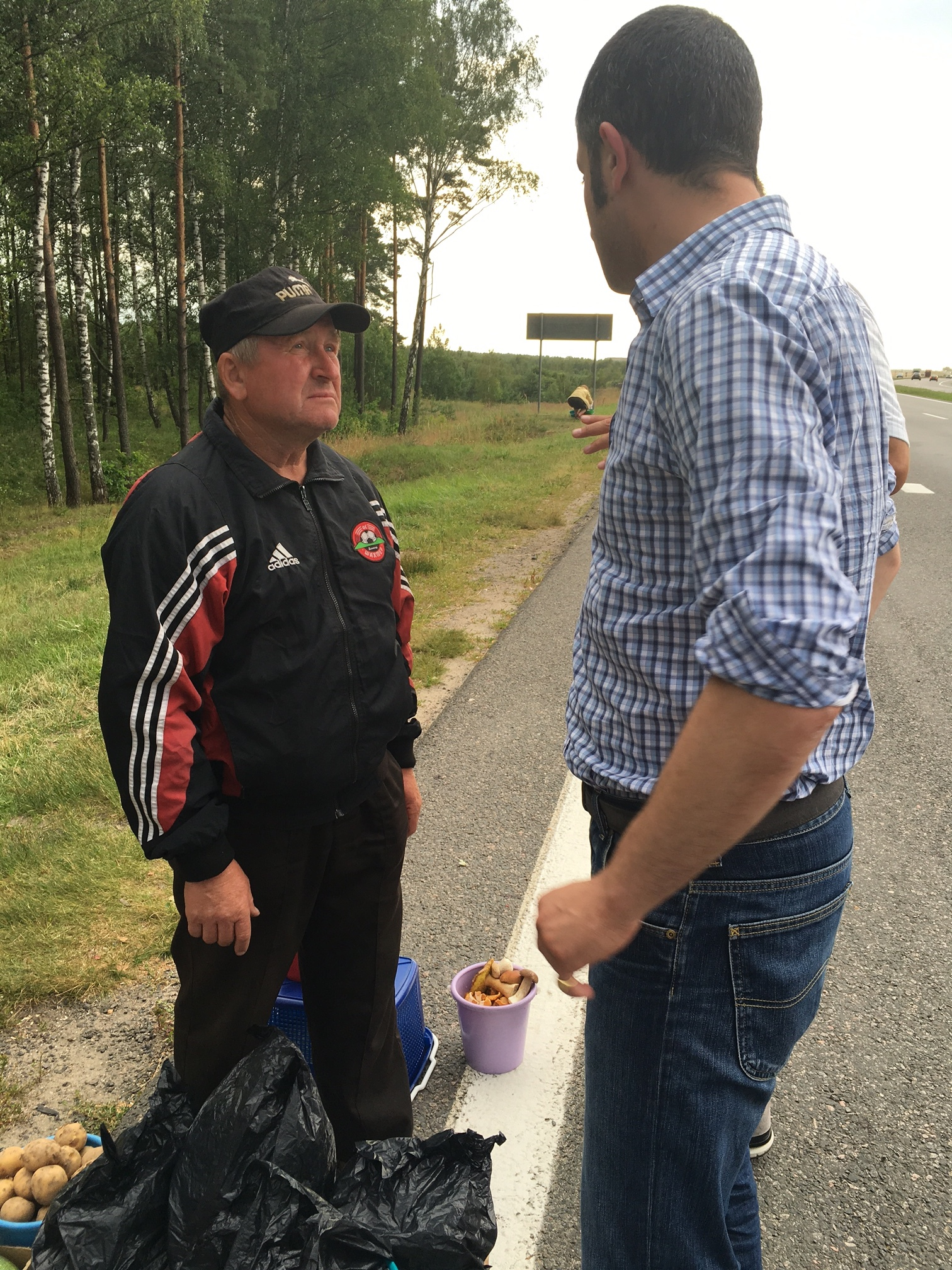 Buying 3kg of blueberries from a fruit seller on the side of the motorway on the way to the border.
