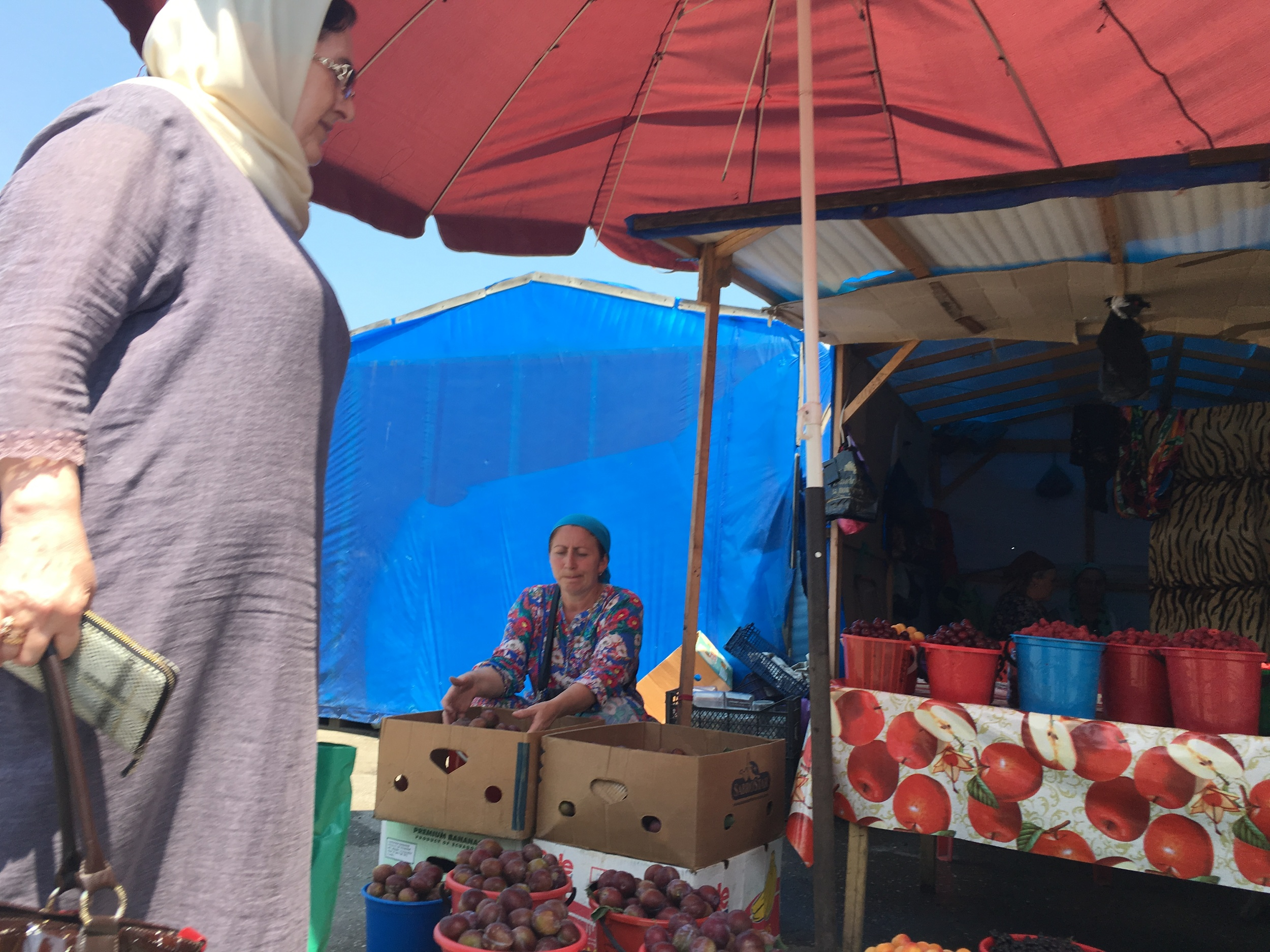 A woman selling fruit at a market in Grozny, Chechnya.