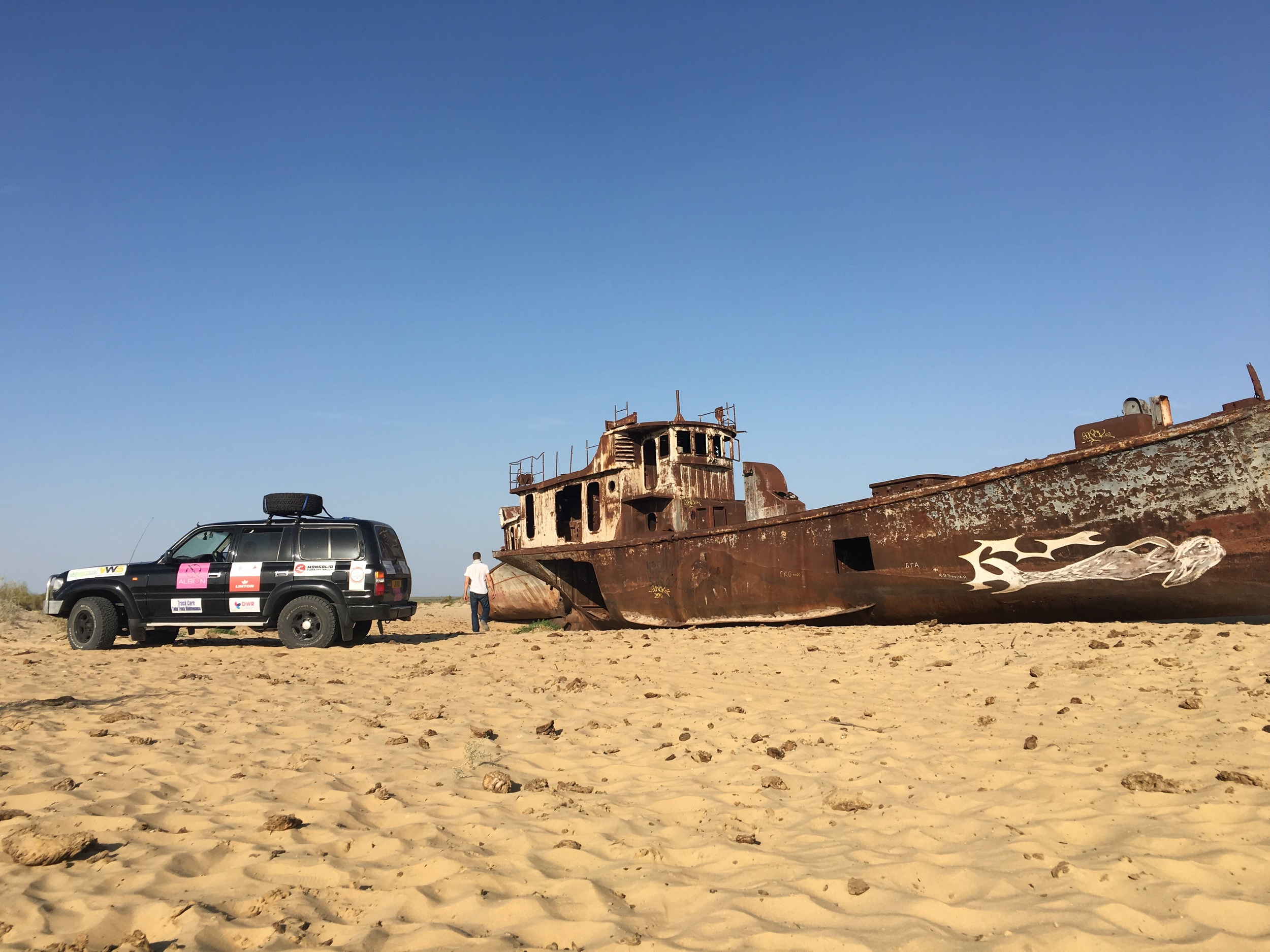 Our car next to one of the abandoned ships.