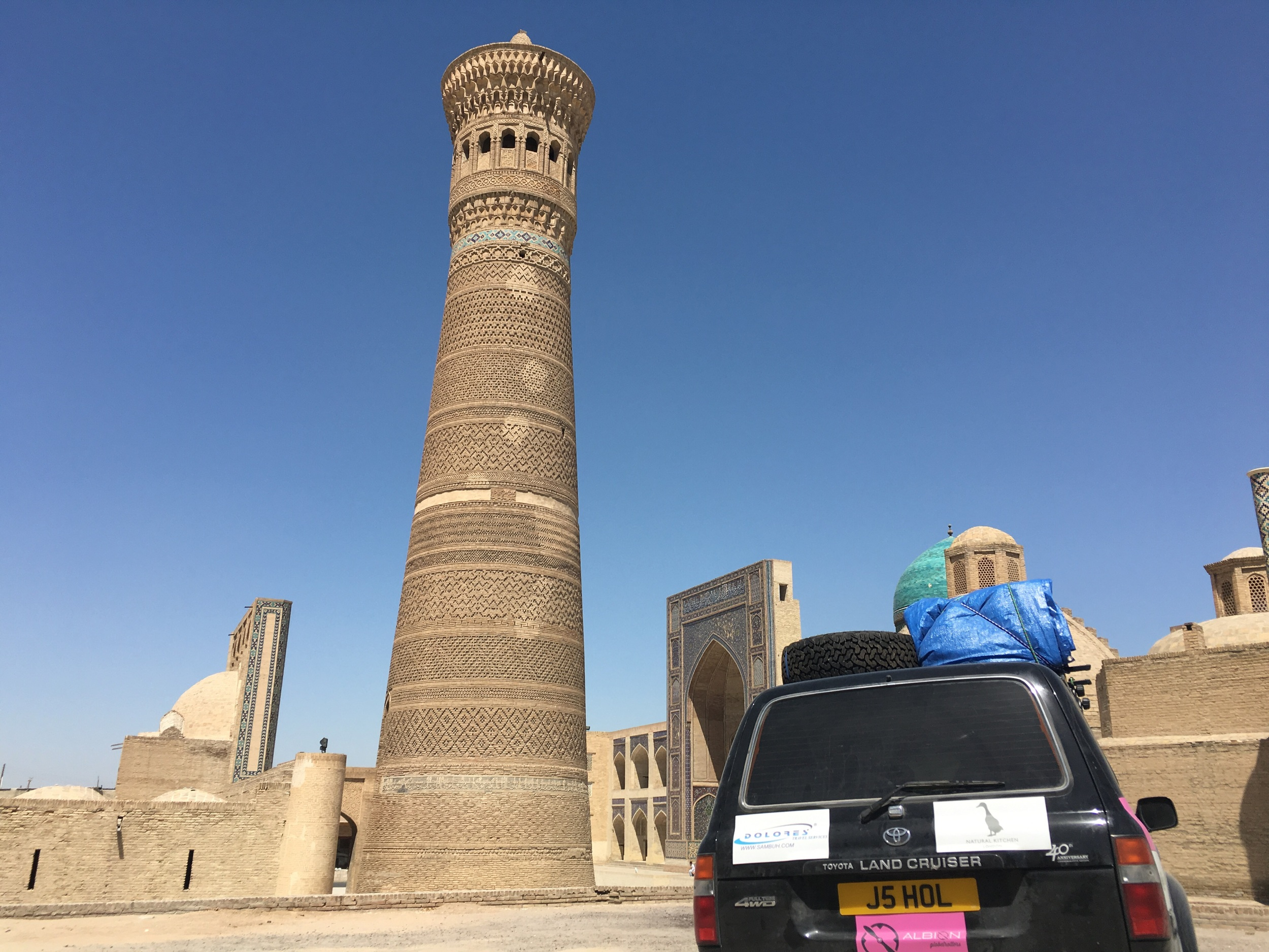 Our car in front of the minaret in Bukhara