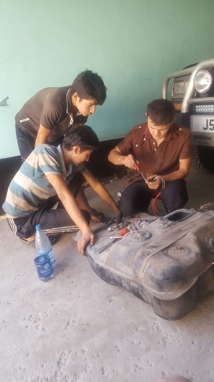 The mechanics working on the fuel pump.