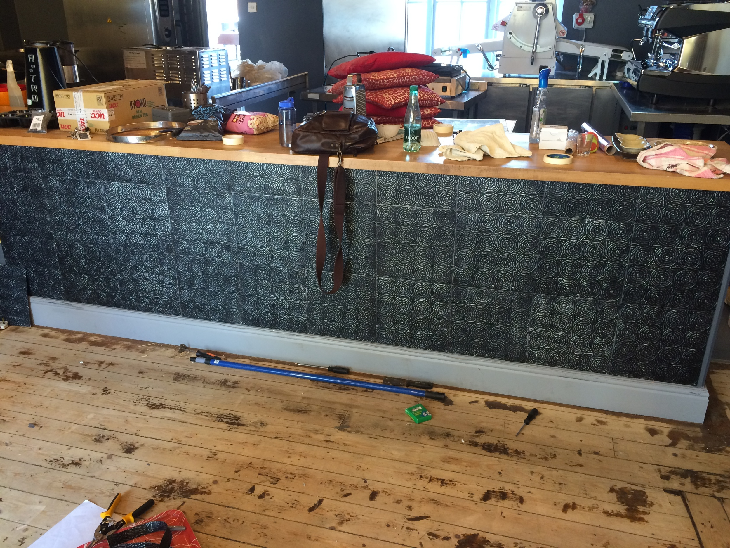 My lovely mother flew all the way from the USA to help hang these awesome tin tiles on the bar!