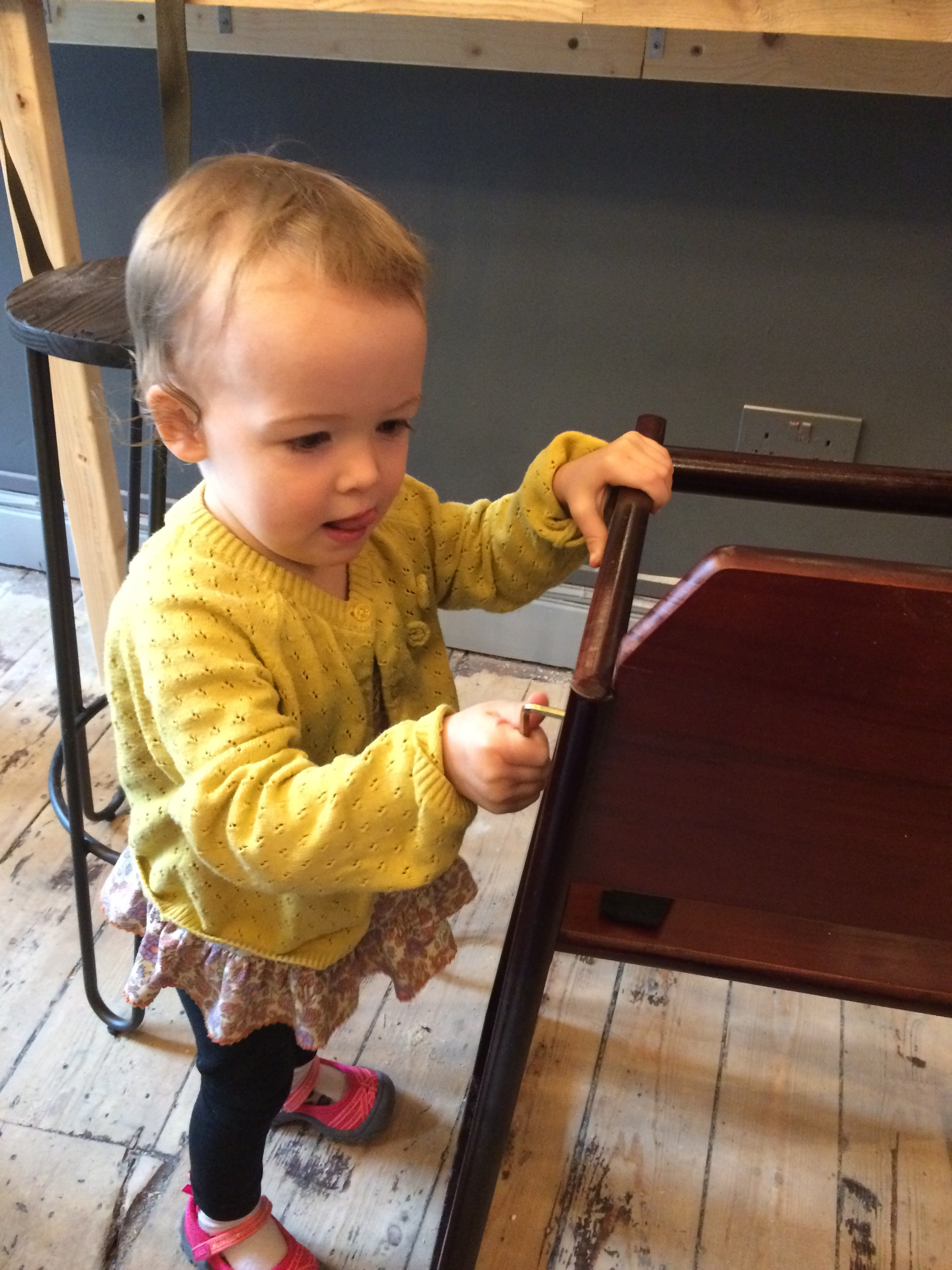 Ella helps build high chairs for new friends to use at Figbar!