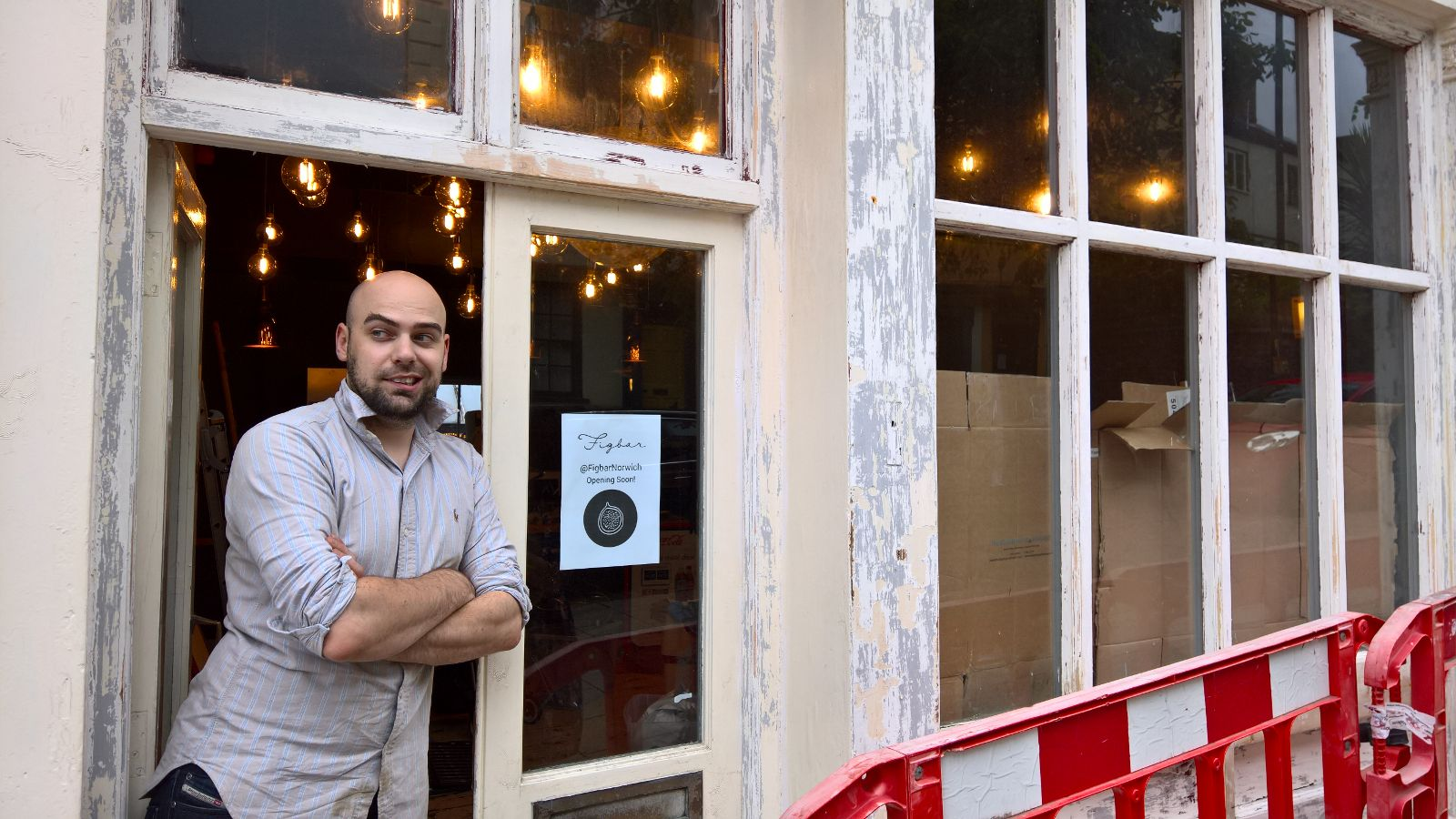Shop front being prepped for new paint and a new sign with lovely model Chef Jaime Garbutt!