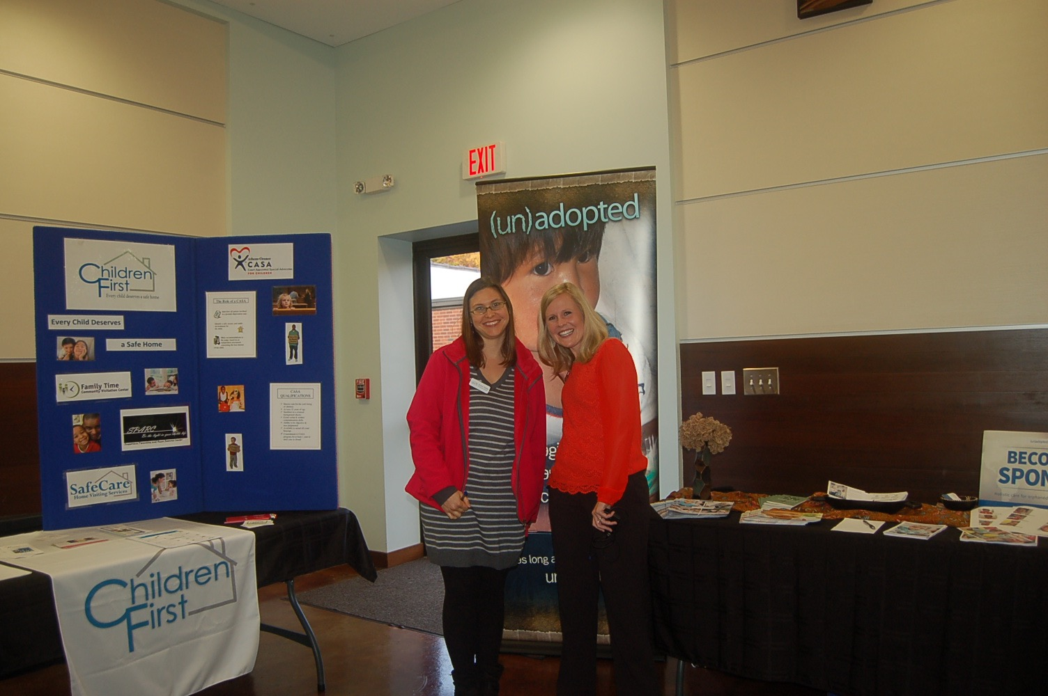 Pictured above are Susie Weller from Children's First and Whitney White from Lifeline Children Services at their booths for the CASA program and (un)adopted program.