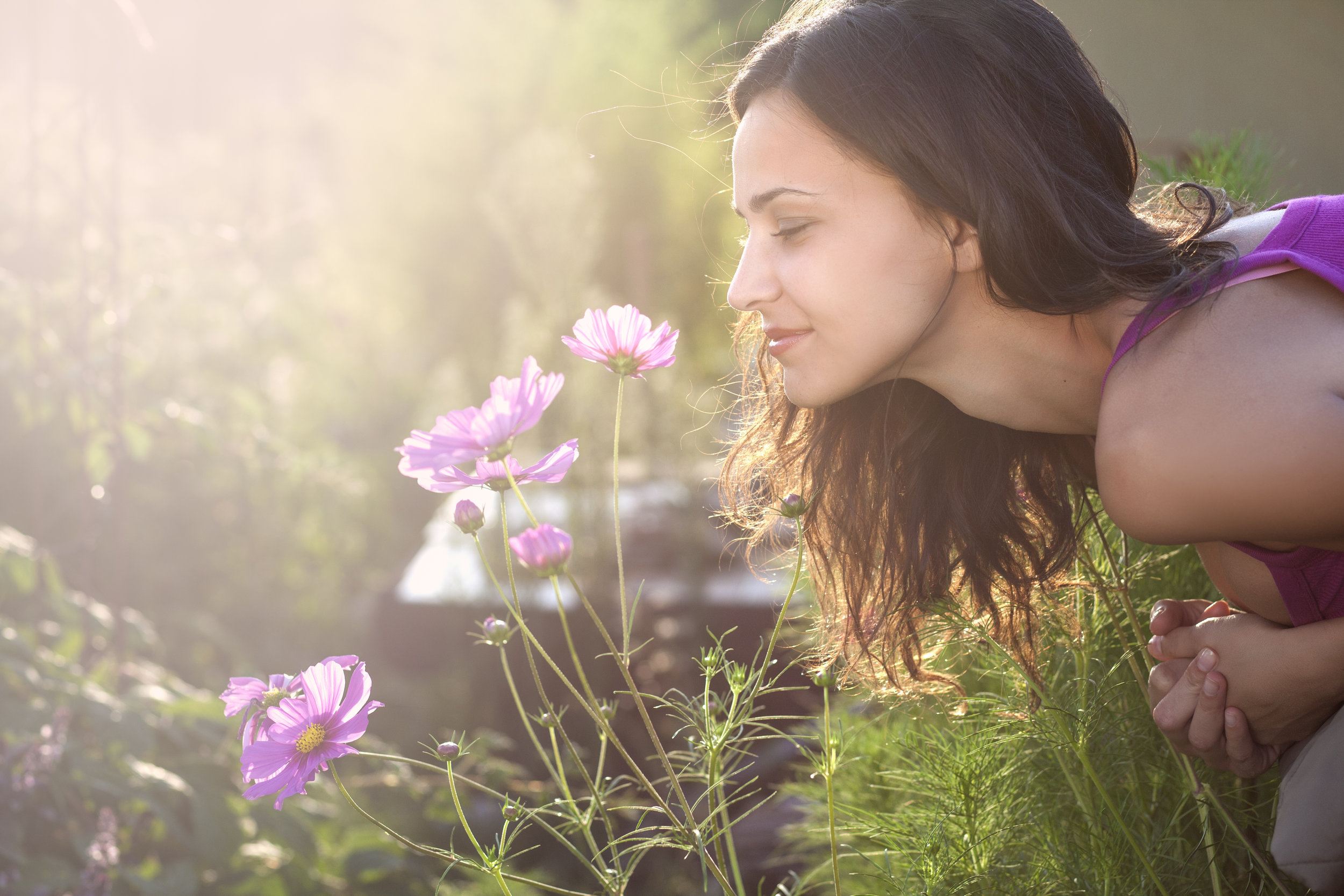 woman-smelling-flower.jpeg