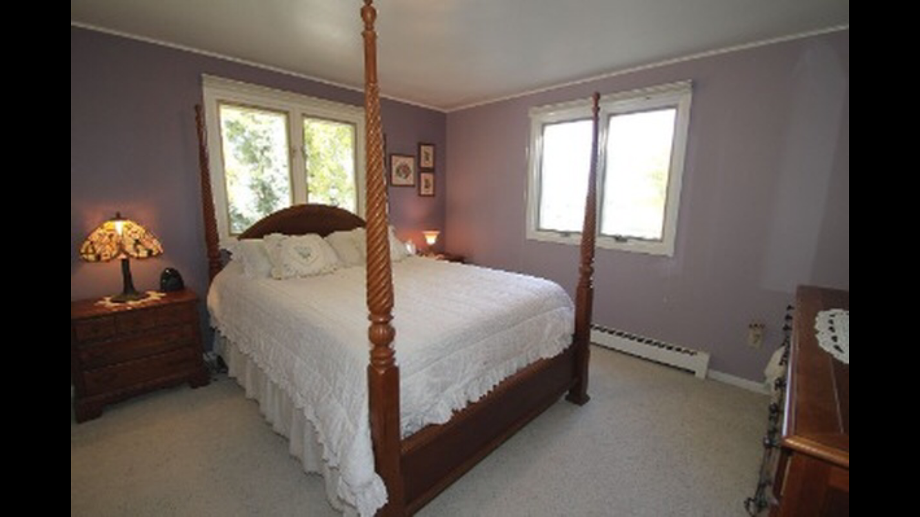 This bedroom has bright purple paint and will be updated with a neutral wall bedroom for a little boy.