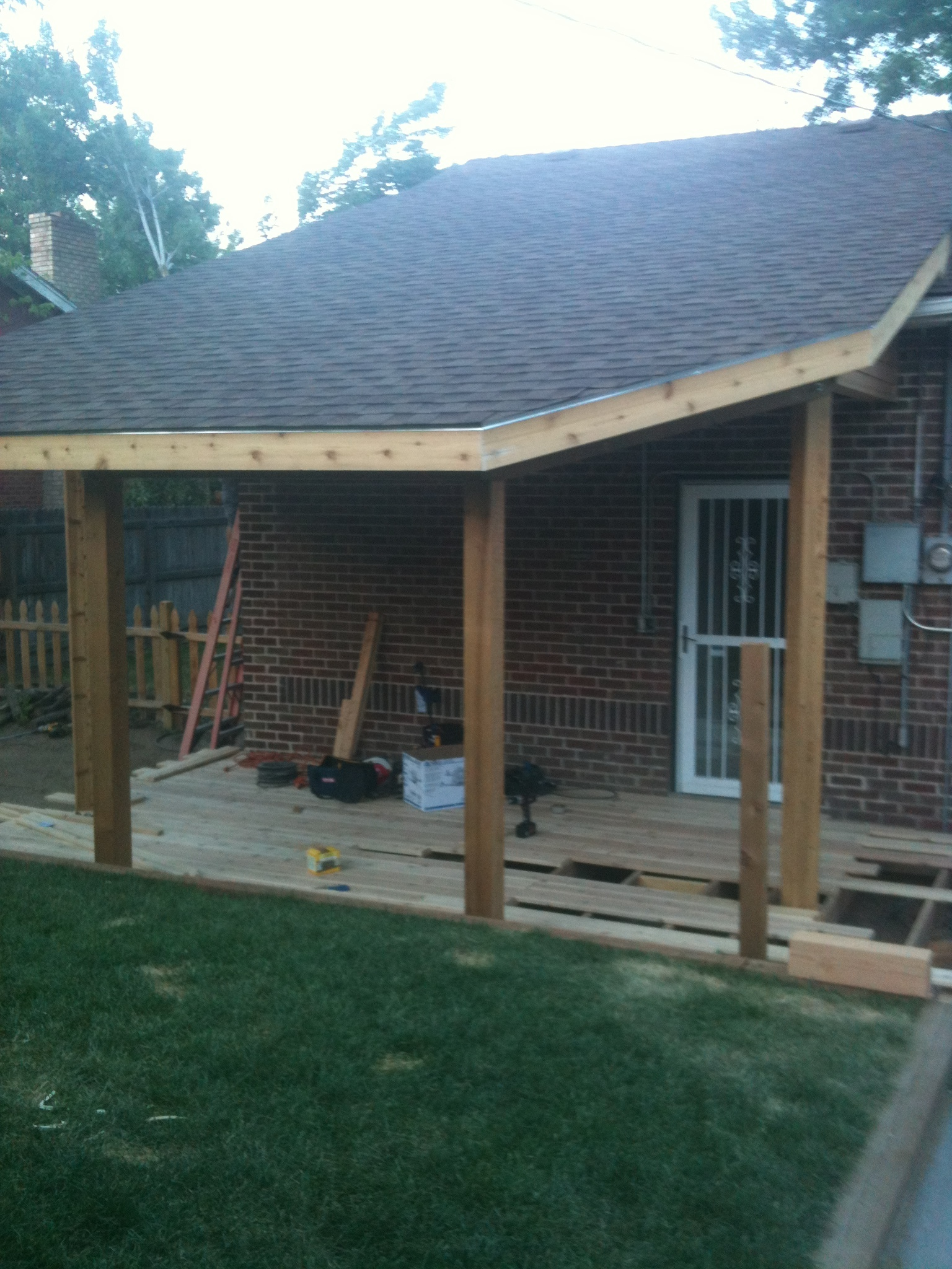 New porch roof with more height to allow more light into the back door