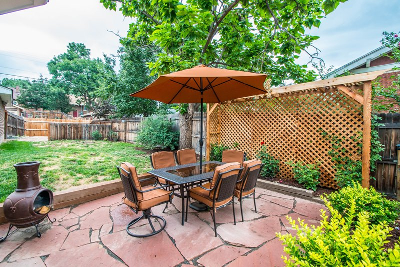 New flagstone patio with rose garden and dining area