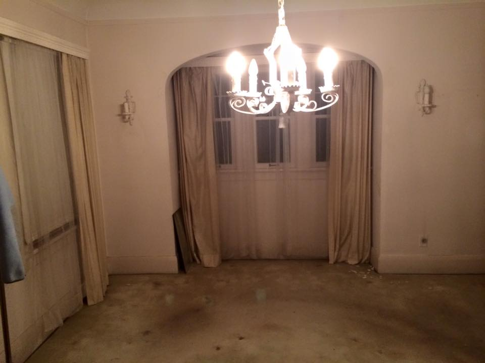 The dining room with paint covering everything & the dirty carpeting.