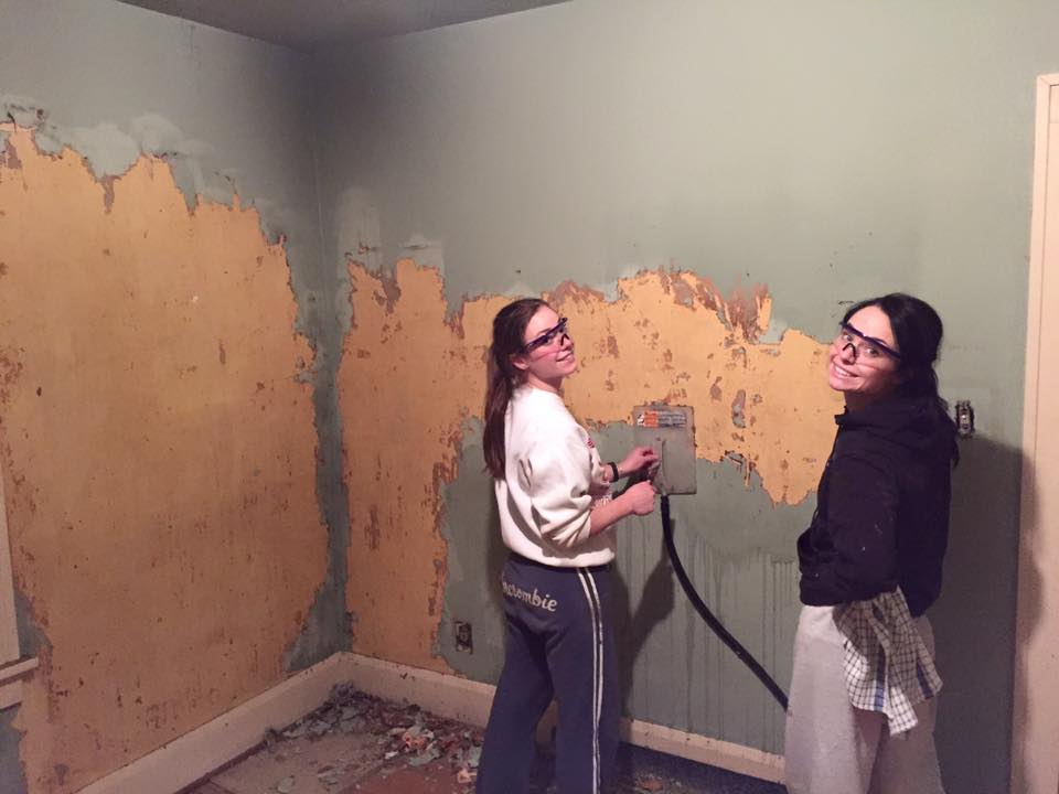 Shannon and here sis, Megan, removing wallpaper in one of the bedrooms