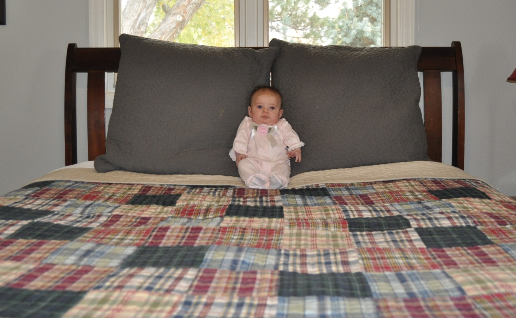 Tommy Hilfiger bedding and a cute little baby doll to snuggle named Evie Mae.