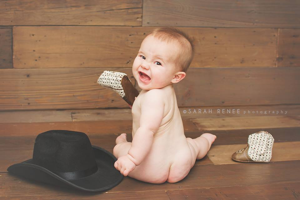 Baby photos in front of the DIY shiplap wall.