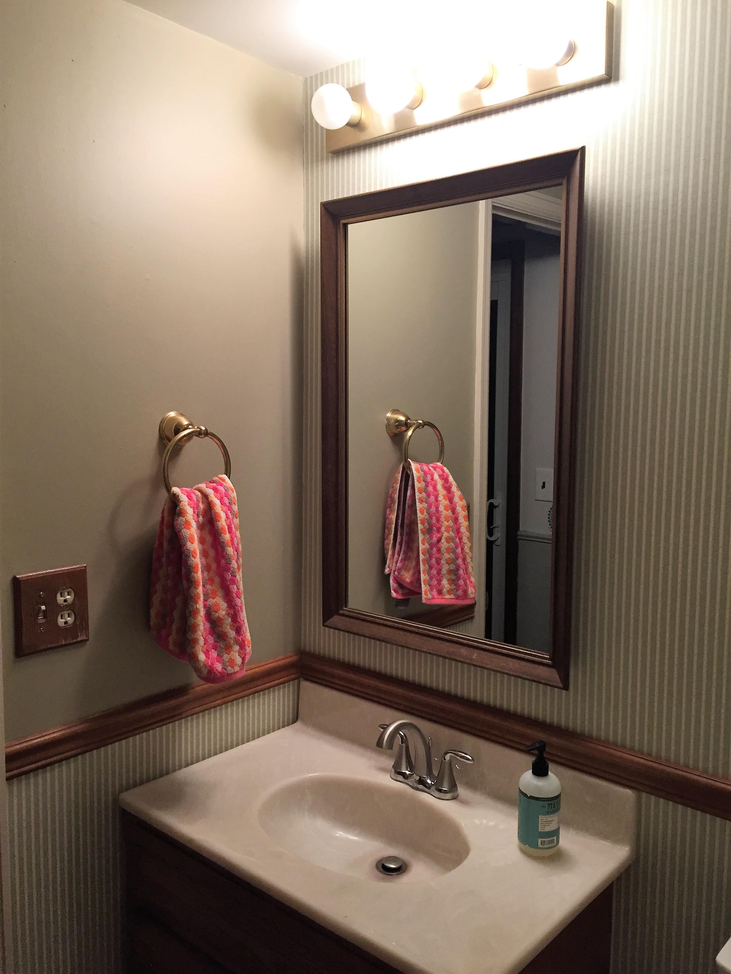 Before photo of the half bathroom