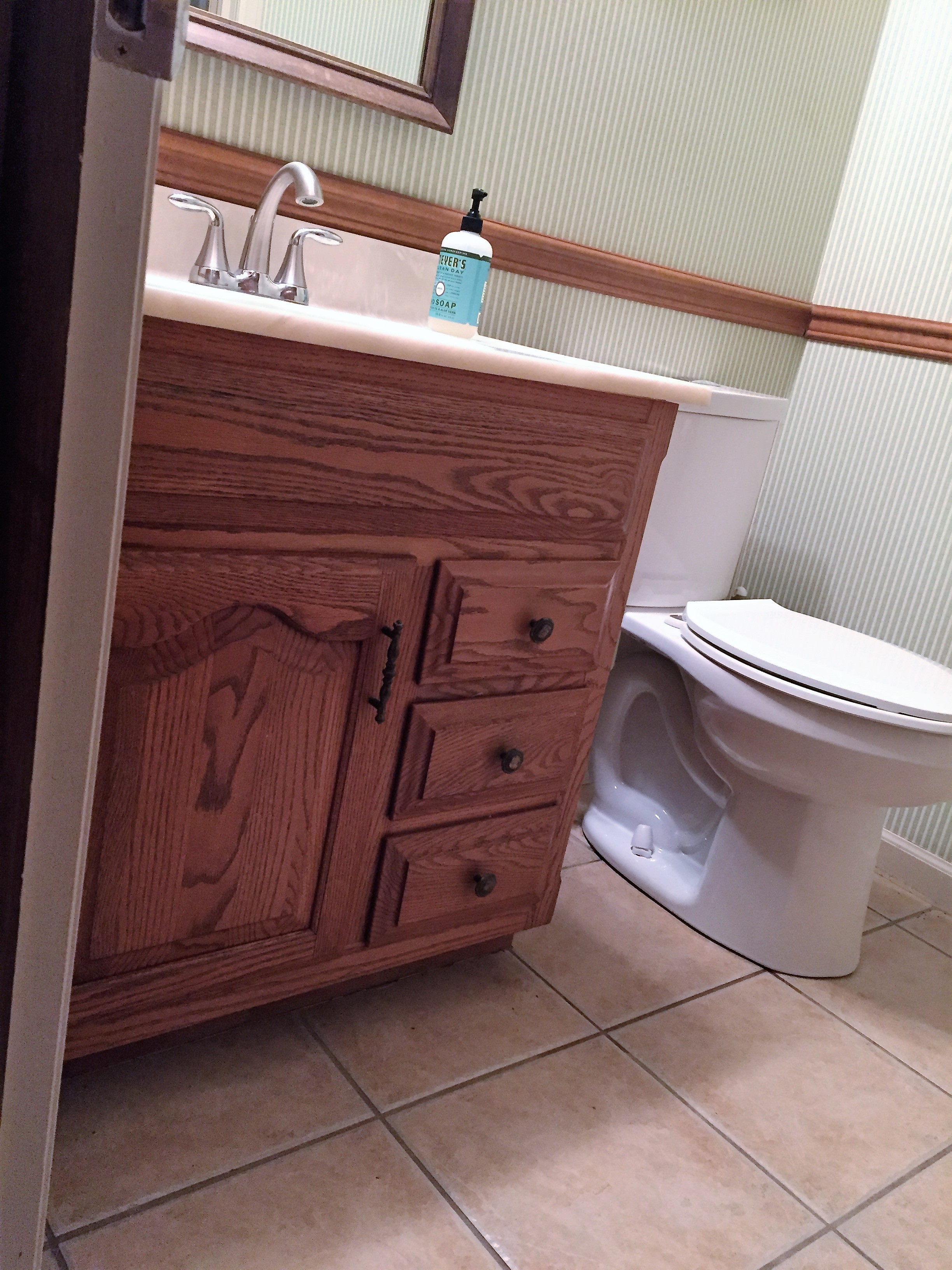 Builder grade vanity in half bathroom