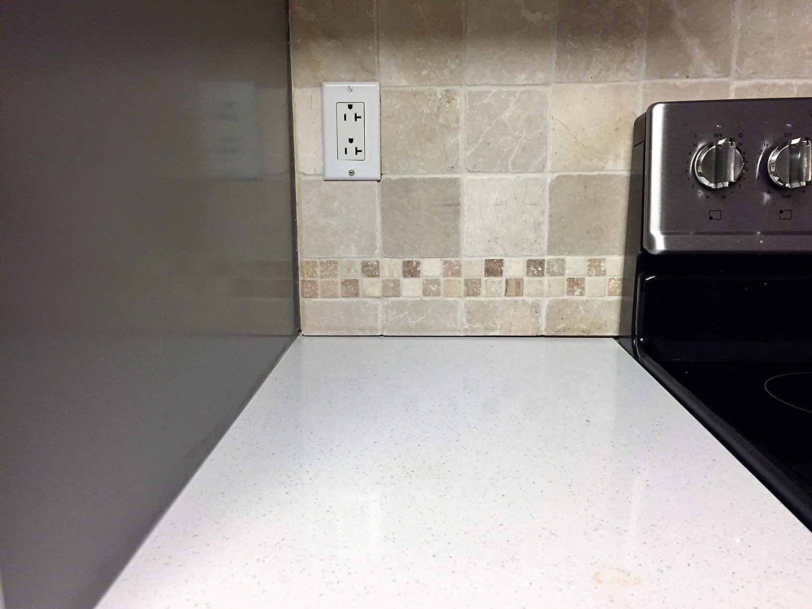 You can see in this picture the visible seam between the tile and counter.