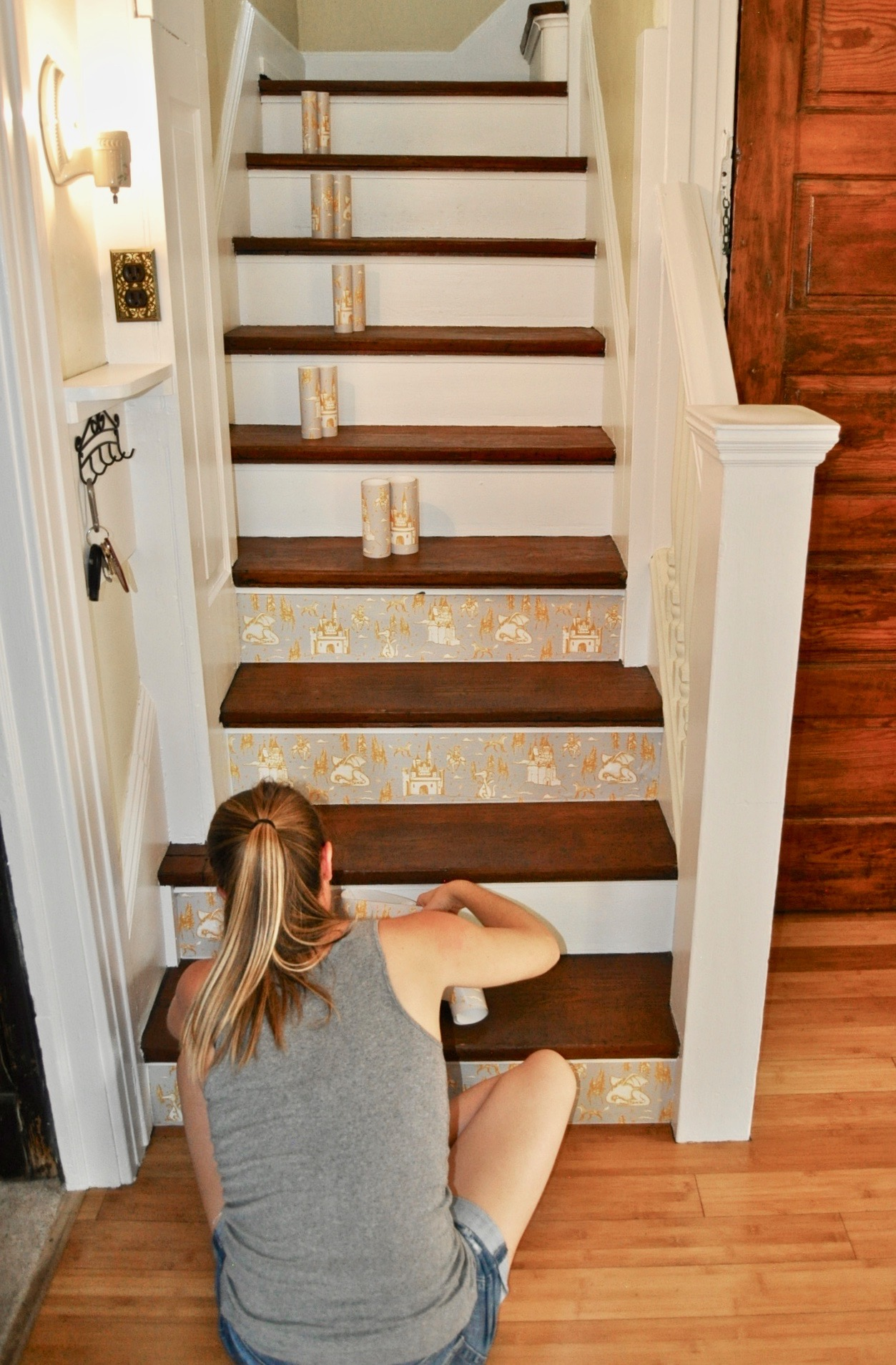 Measure your stair treads and pre-cut the wallpaper for each step.
