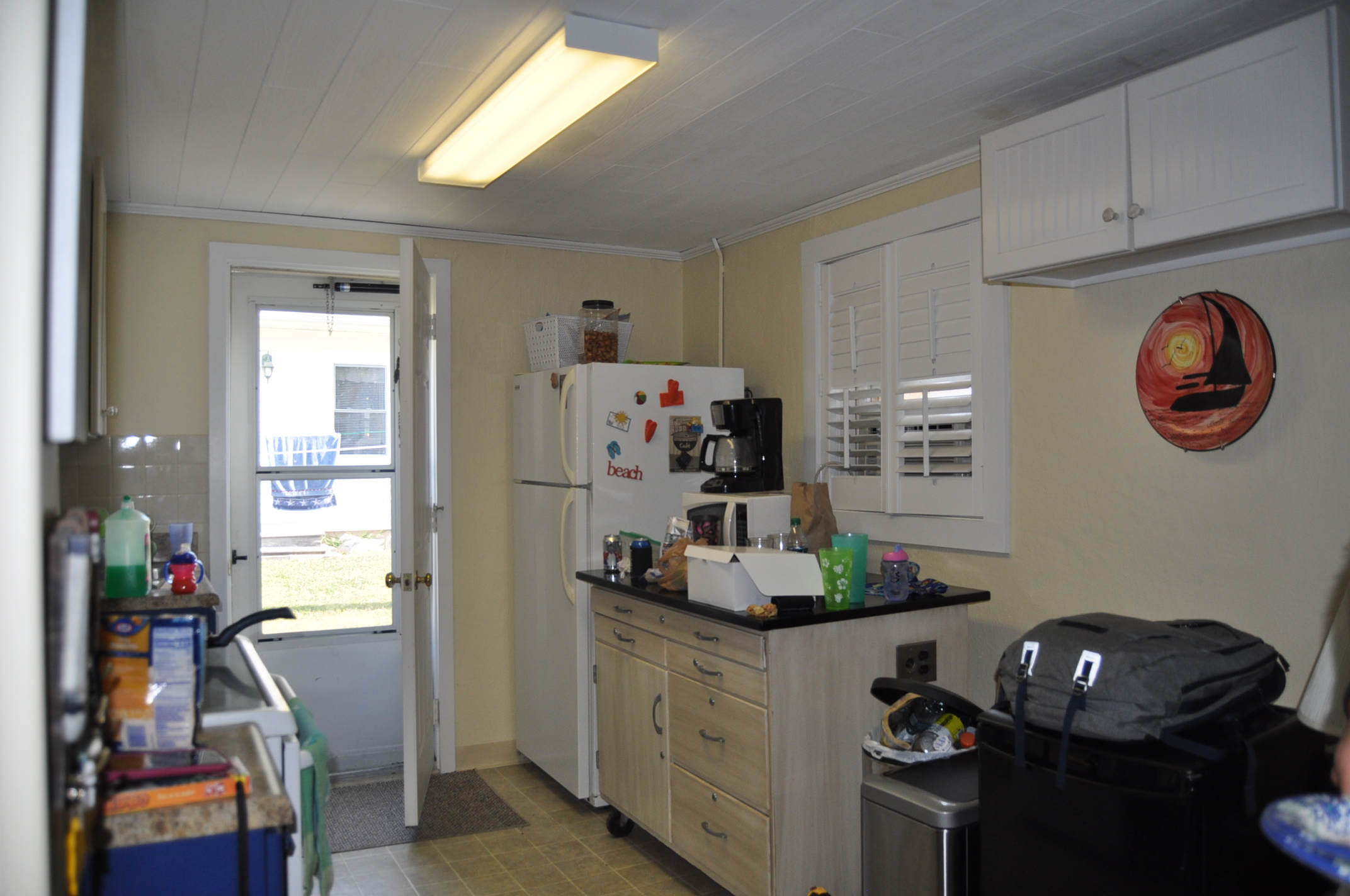 Cluttered kitchen before staging
