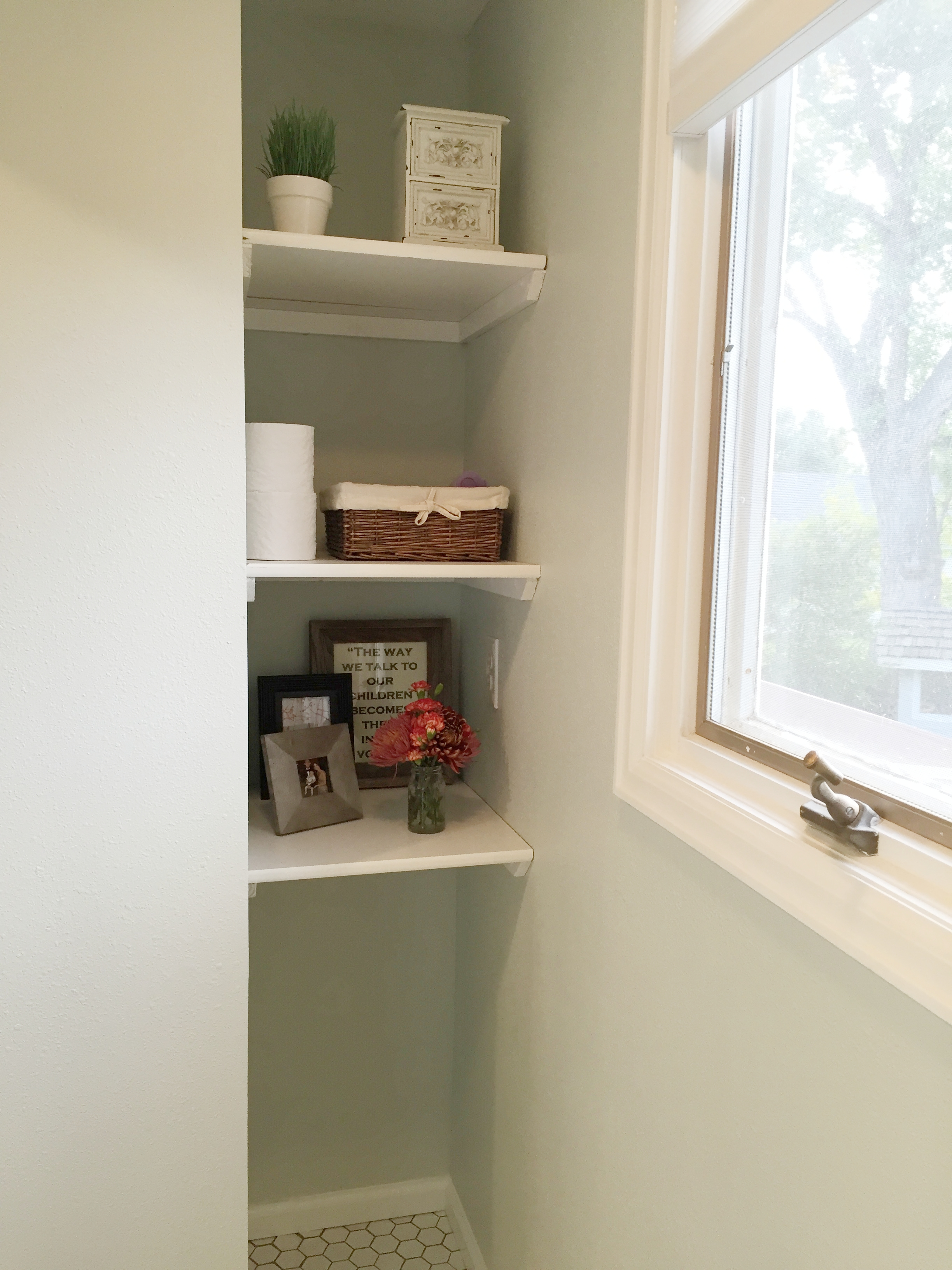 We added shelving into the nooks of this bathroom to maximize storage space.